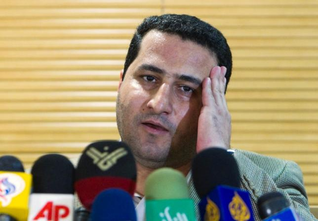 Iranian scientist Amiri speaks with journalists as he arrives at the Imam Khomini airport in Tehran