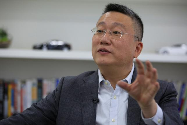 Freeman Shen, founder and CEO of WM Motor Technology Co., Ltd. speaks during an interview with Reuters at his office in shanghai
