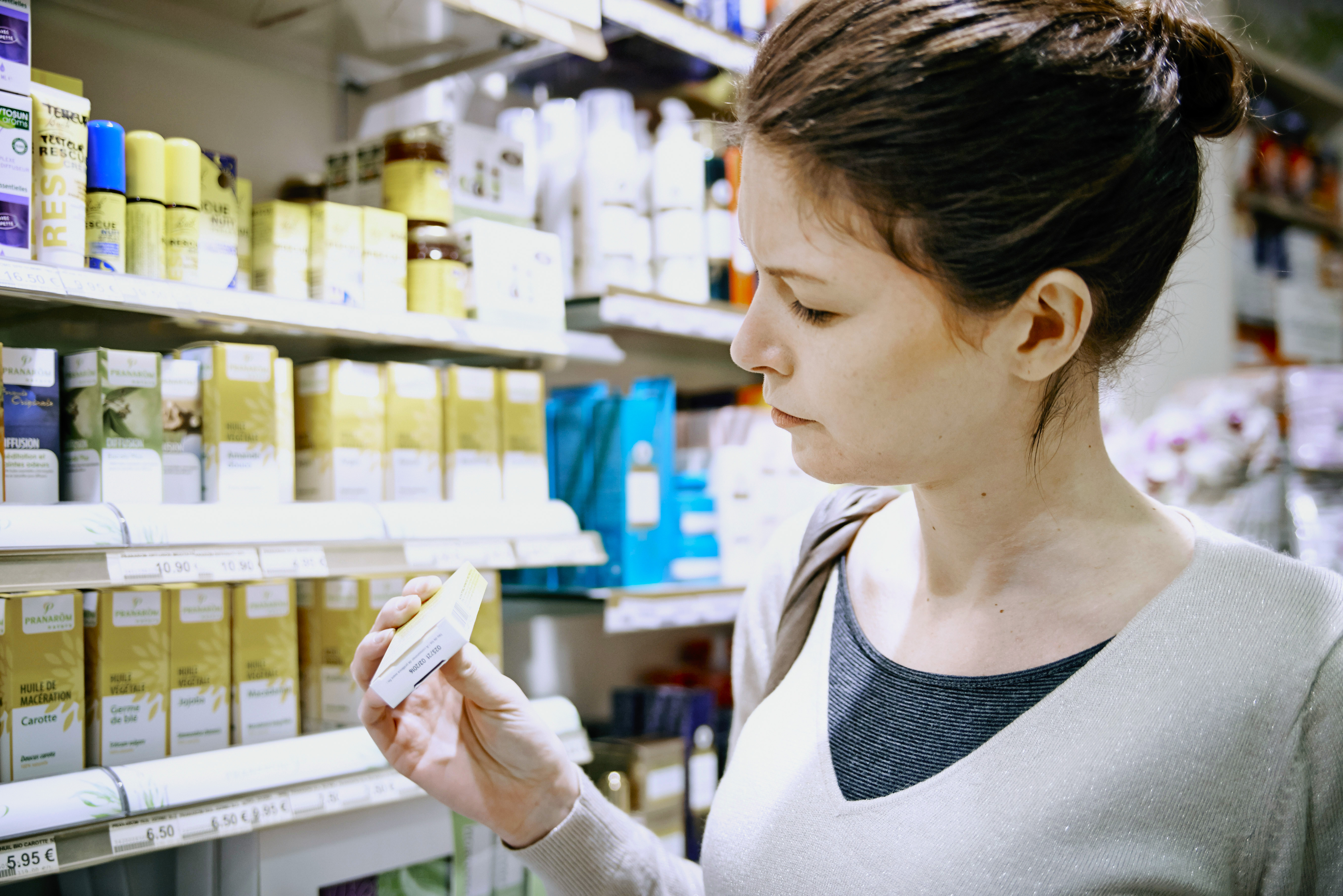 Woman holding Bach flower capsules.