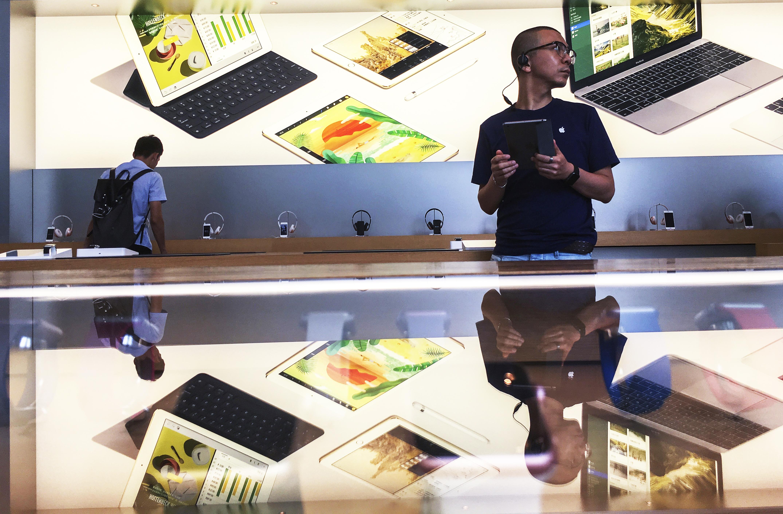 Customers in an Apple shop in Beijing Dawanglu CBD.  As