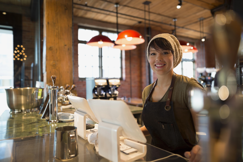 Portrait smiling barista in coffee shop
