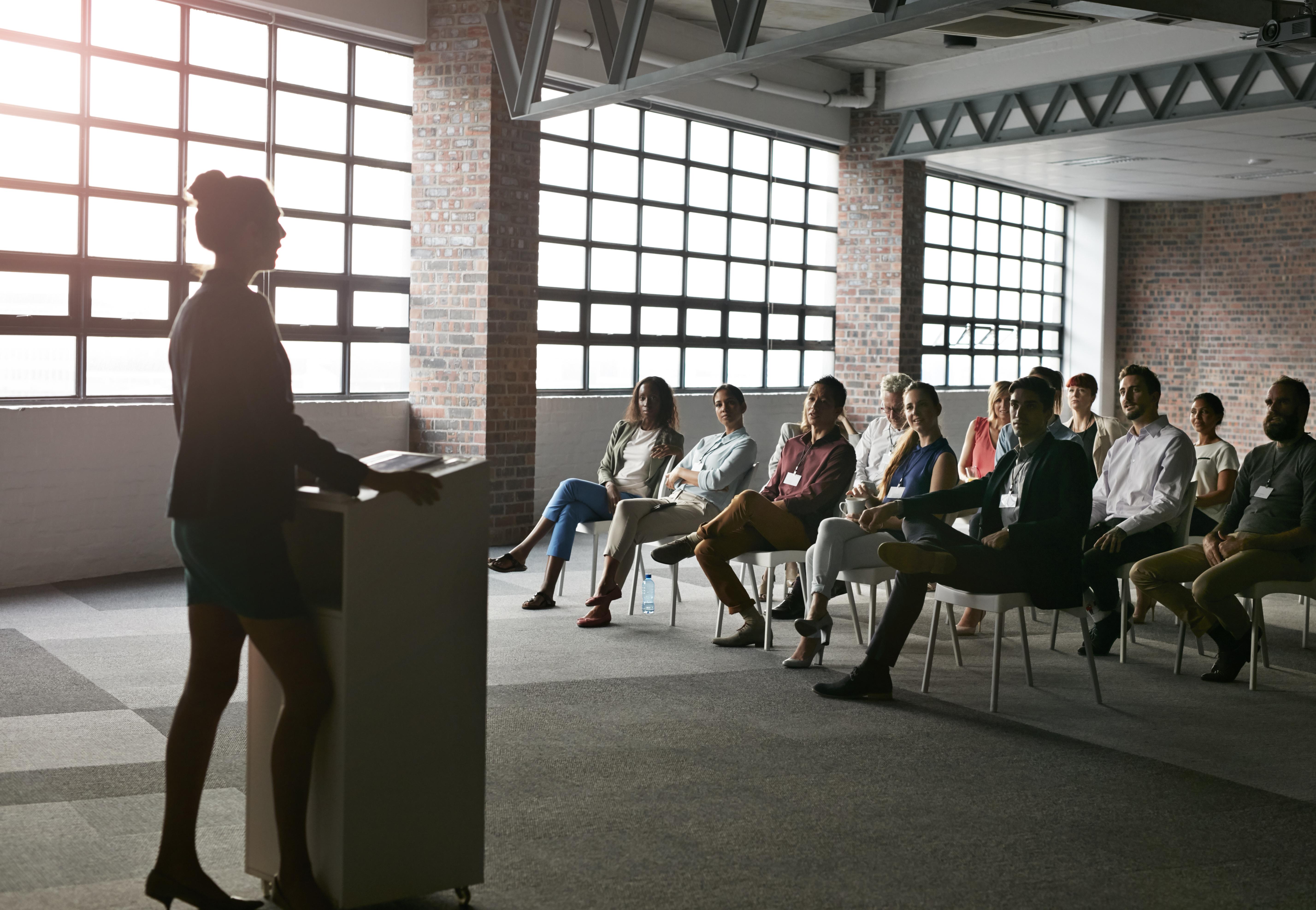 Businesswoman doing presentation in auditorium