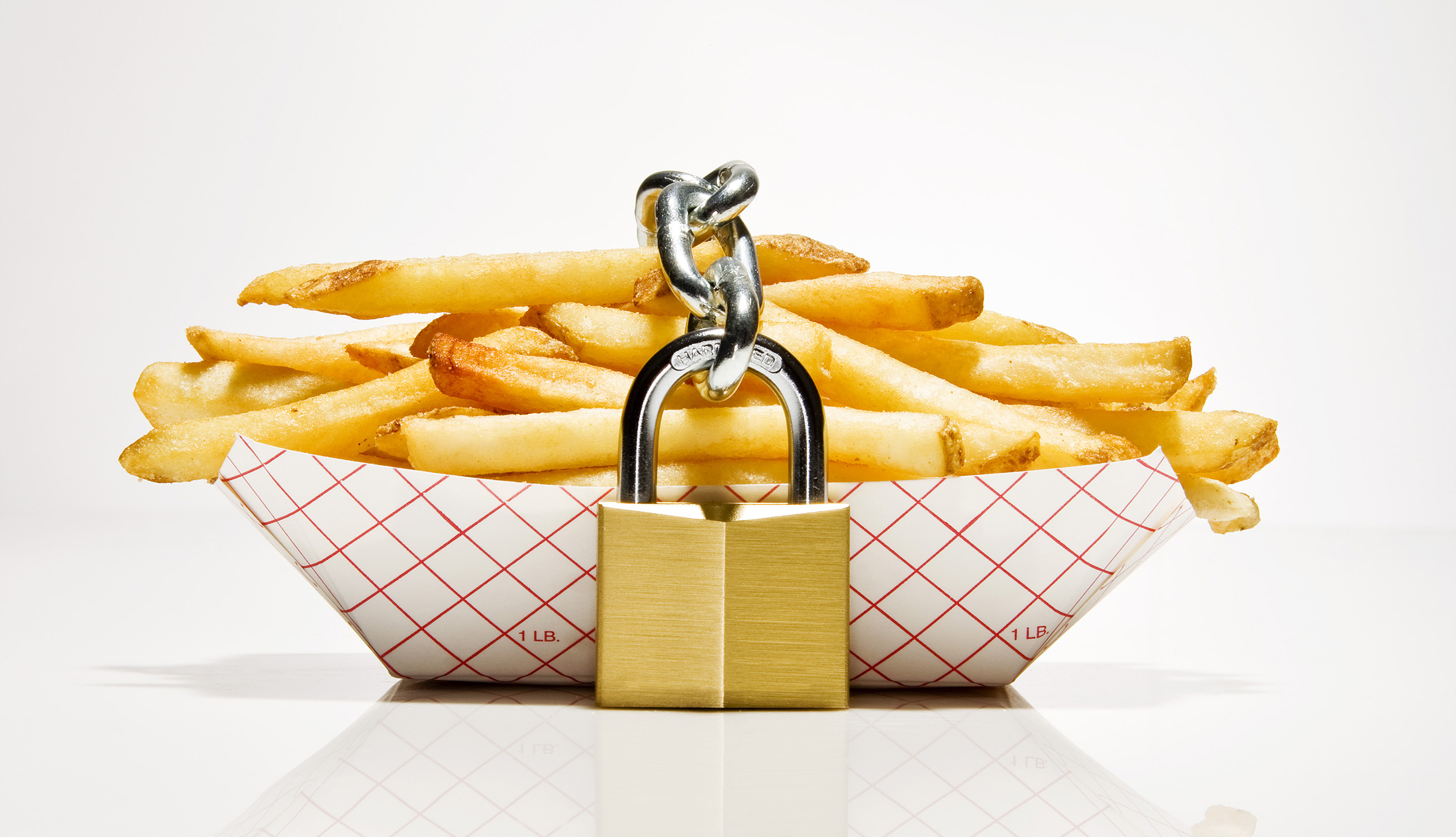 Serving of french fries with lock around them