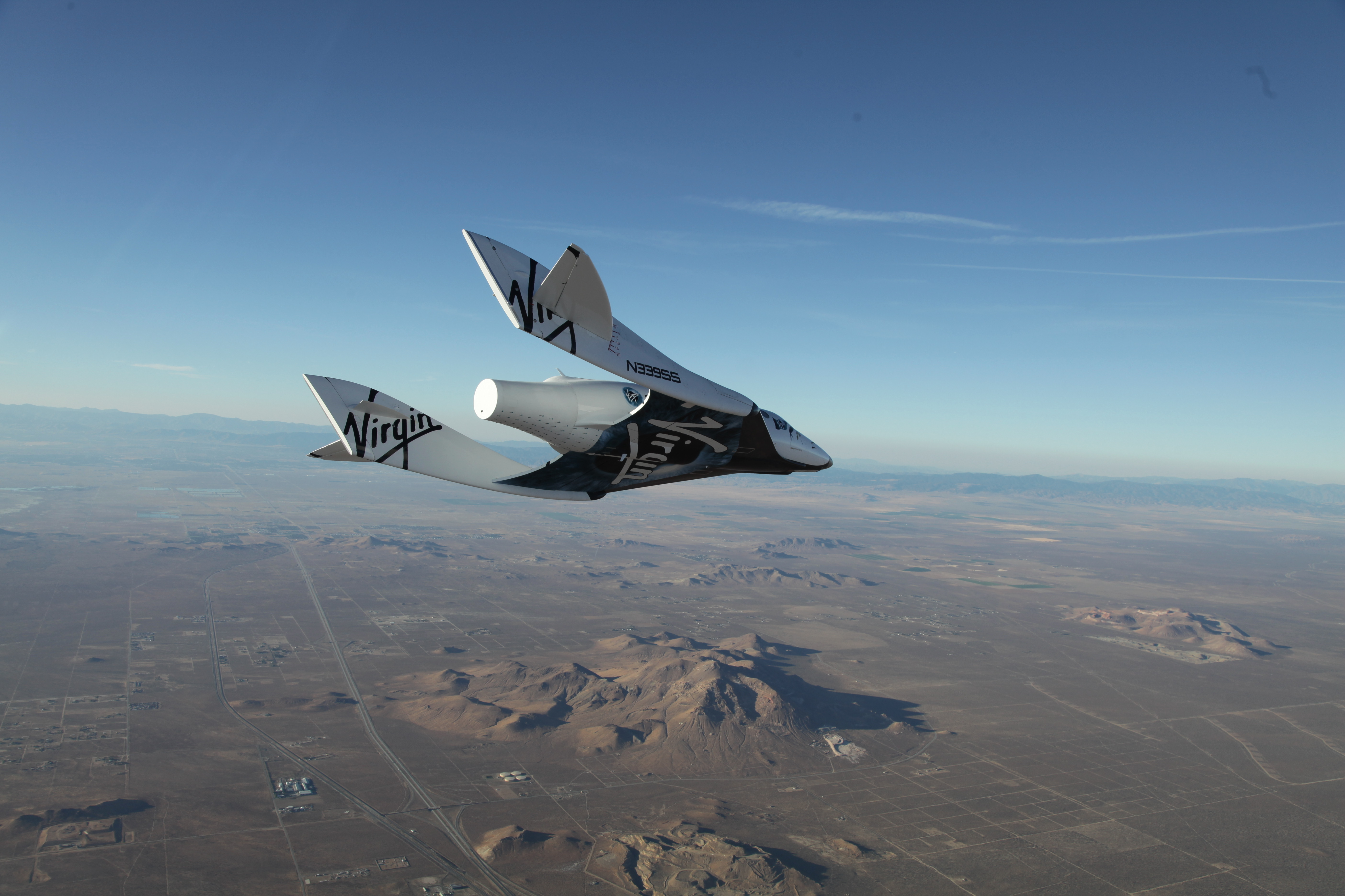 The first SpaceShipTwo during a glide flight over the Mojave desert.