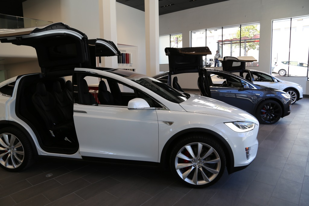 Tesla's Model X SUV cars are on display