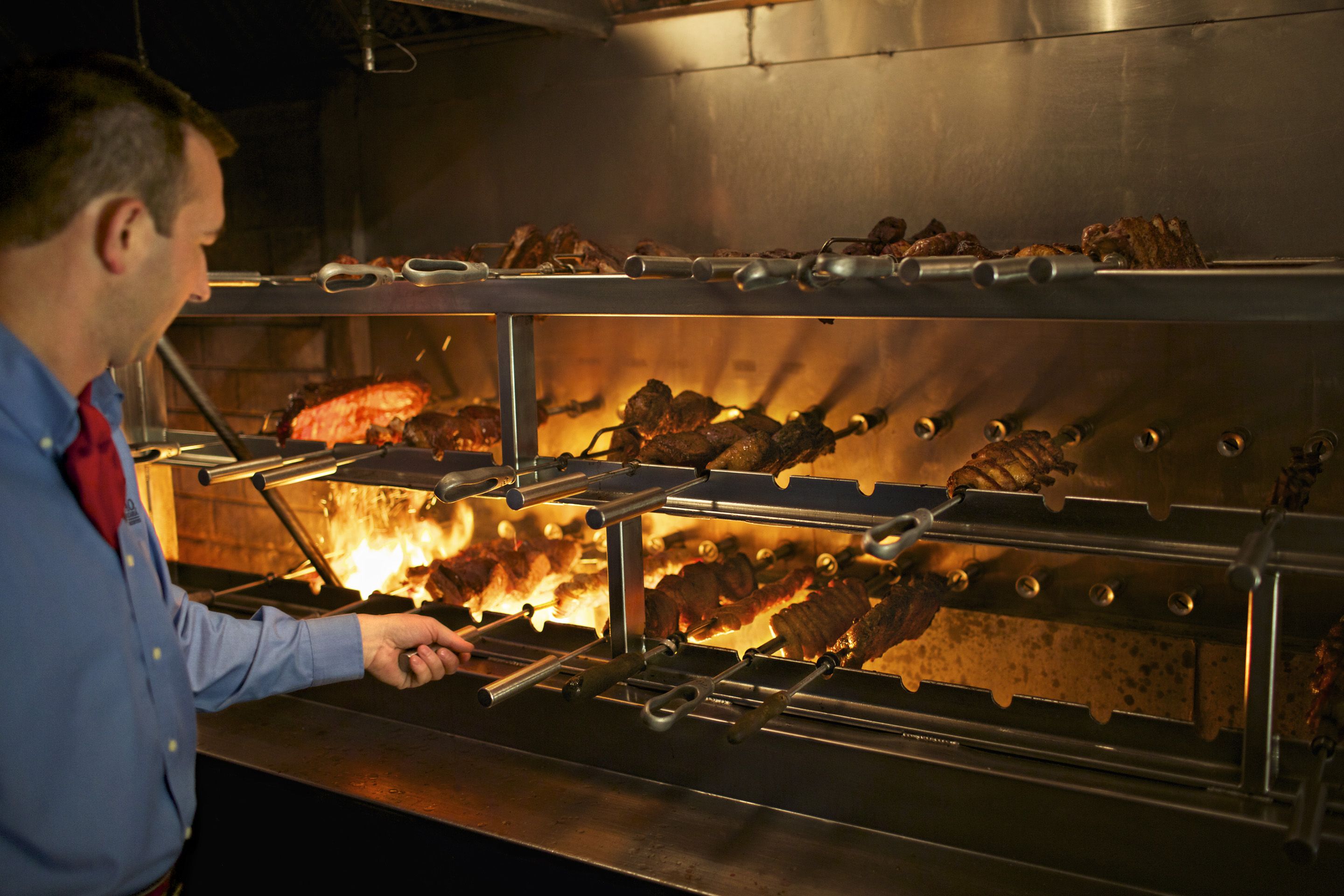 The various meats prepared at Fogo de Chão are served by specially trained gaucho chefs.
