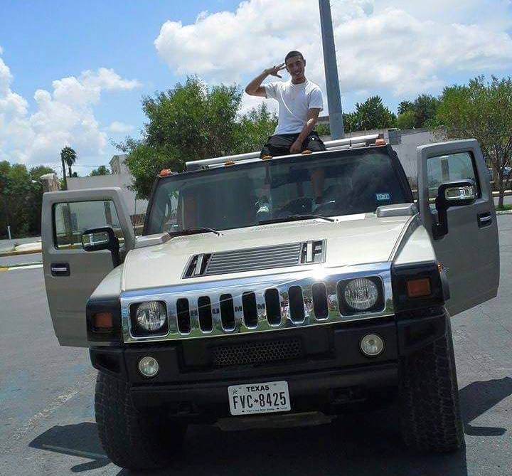 Accused car thief Jesse Zalaya, posing with a Hummer with Texas plates in a Facebook photo posted on July 29th from Matamoros, Mexico.