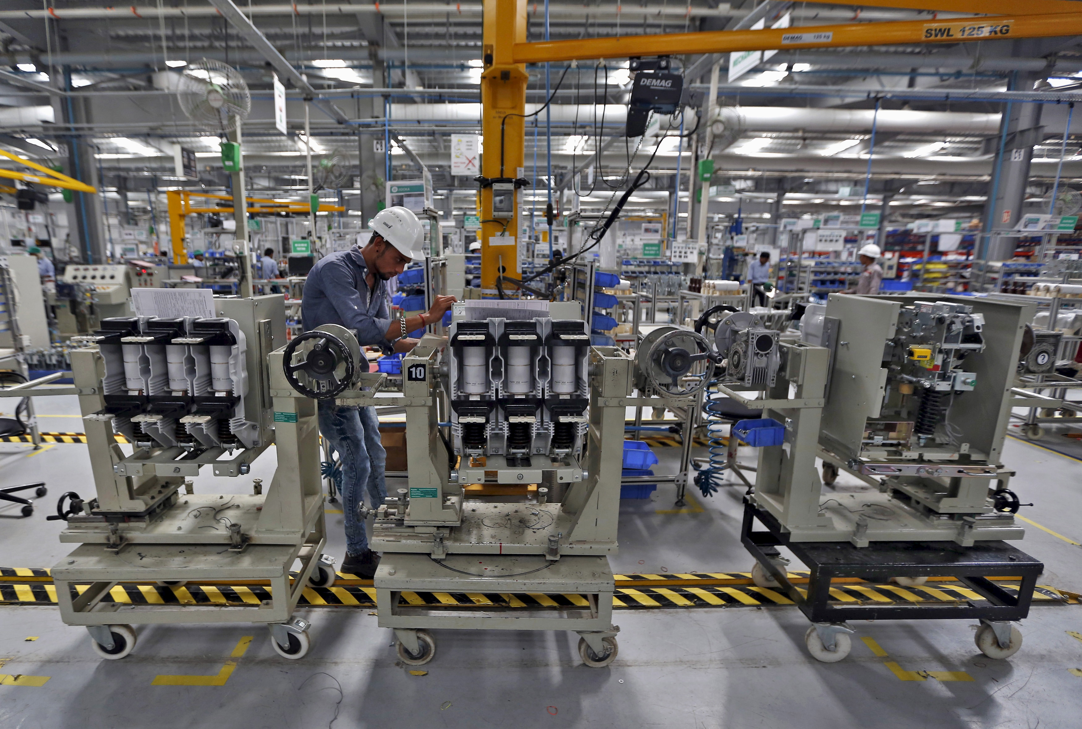 An employee assembles medium voltage switchgears inside the plant of Schneider Electric Infrastructure Ltd. on the outskirts of Vadodara in Gujarat