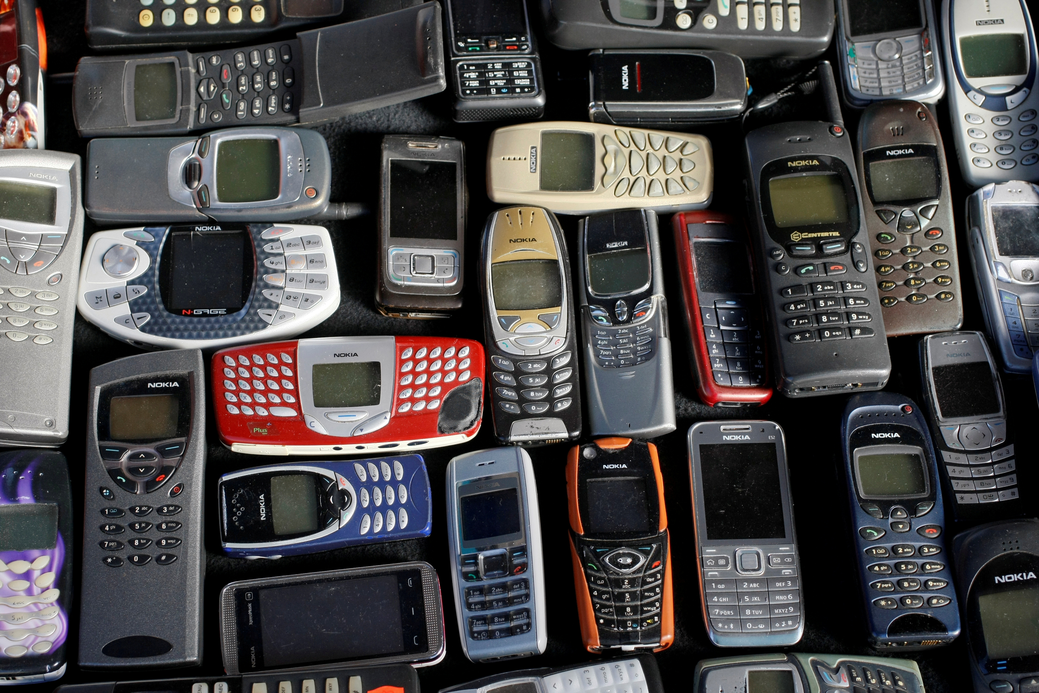 Photo illustration of a collection of mobile phones made by Nokia
