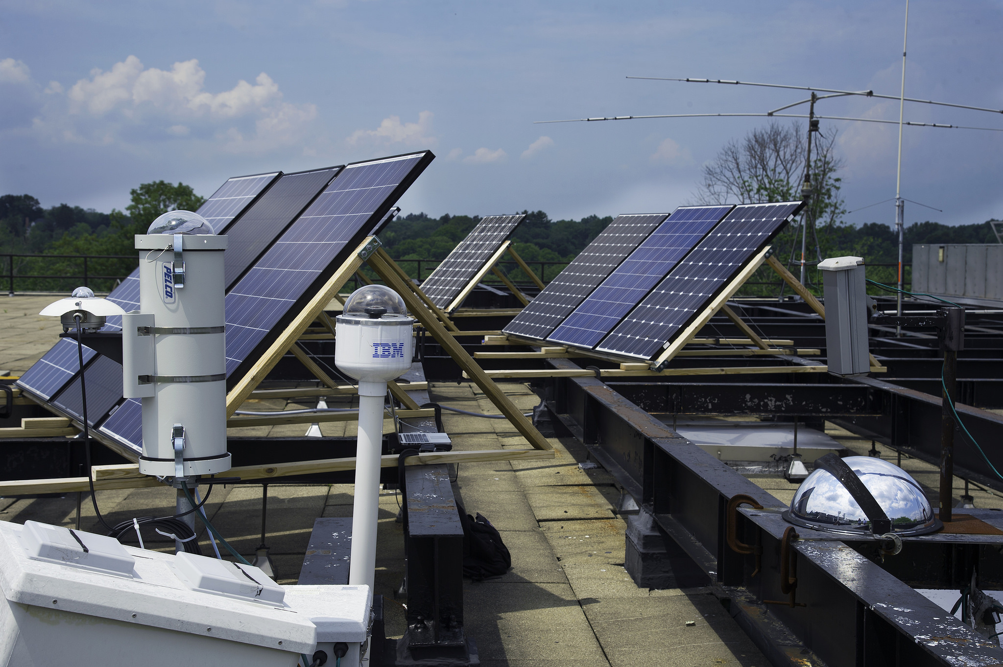 Three generations of cloud cameras installed on the roof of IBM labs used for IBM's solar forecasting technology.