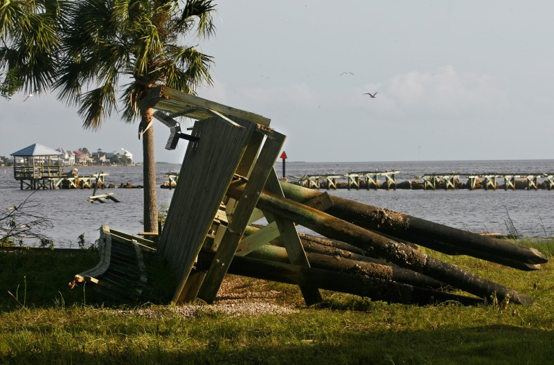 A section of the pier washed up on land as rain and wind from Hurricane Hermine hit the town of Keaton Beach, Florida