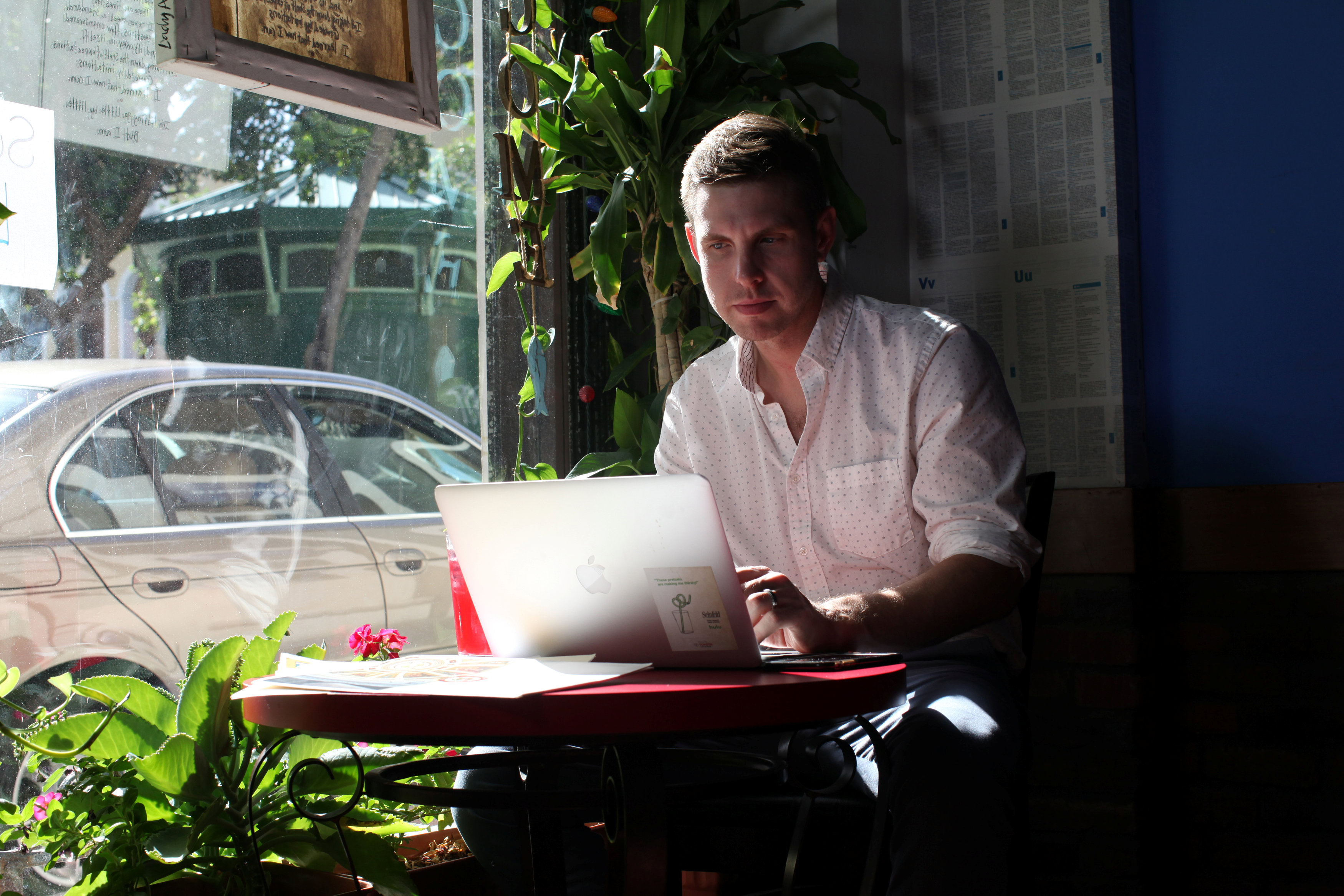 Reuters journalist Nick Brown works at his laptop at a cafe in San Juan