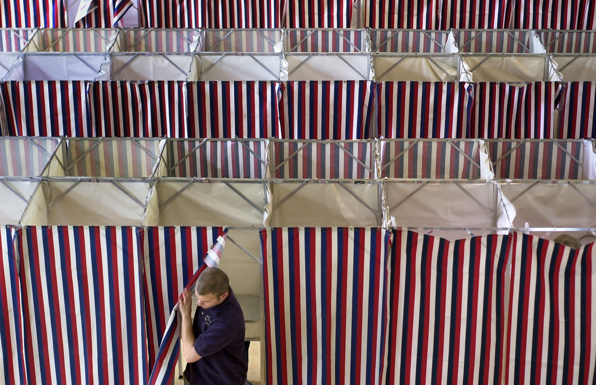 A man leaves a booth after voting at Kennebunk Town Hall on Tuesday. In addition to the state primar