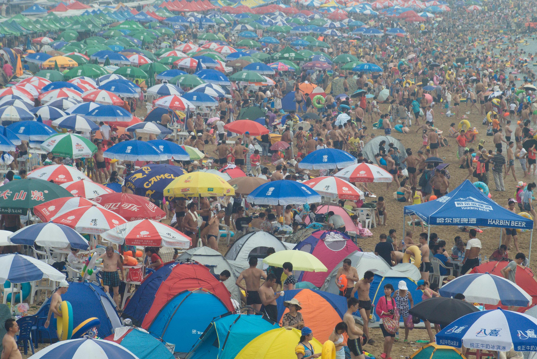 Crowds Cool Off At Fujiazhuang Beach In Dalian