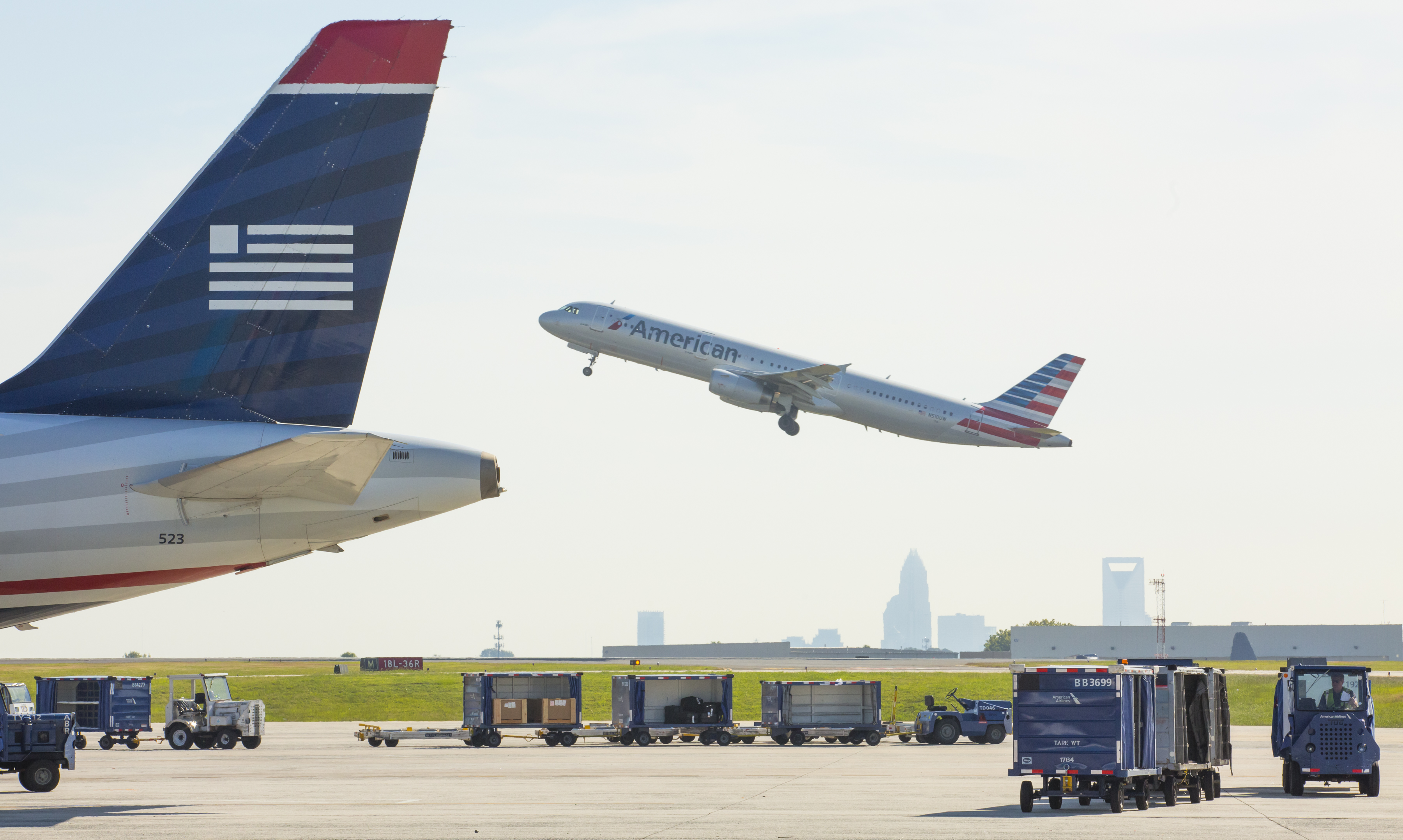 The Logistics Behind The US Airways And American Airlines Merger In Charlotte, NC