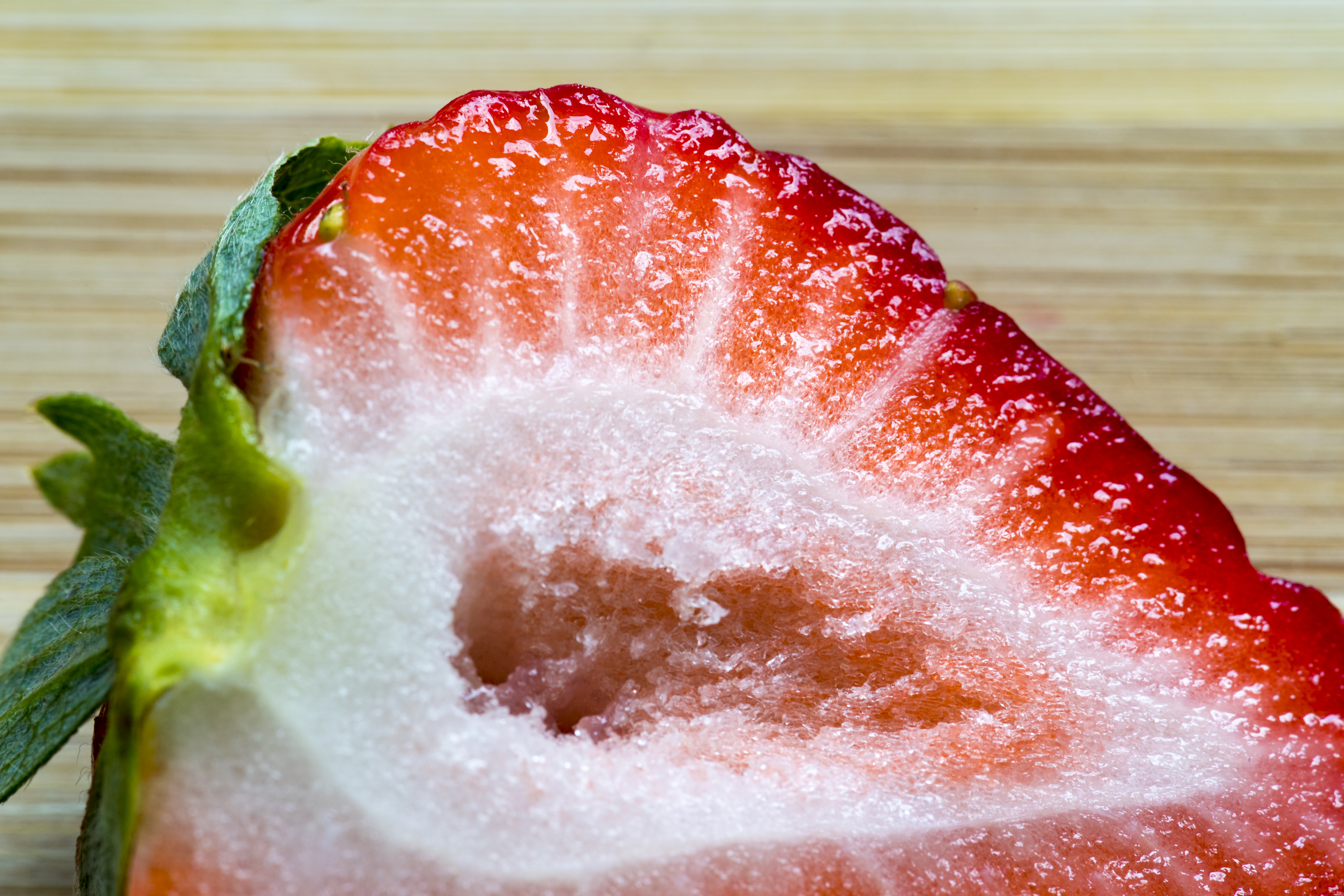 Strawberry close up: Fruit cut in half. The garden