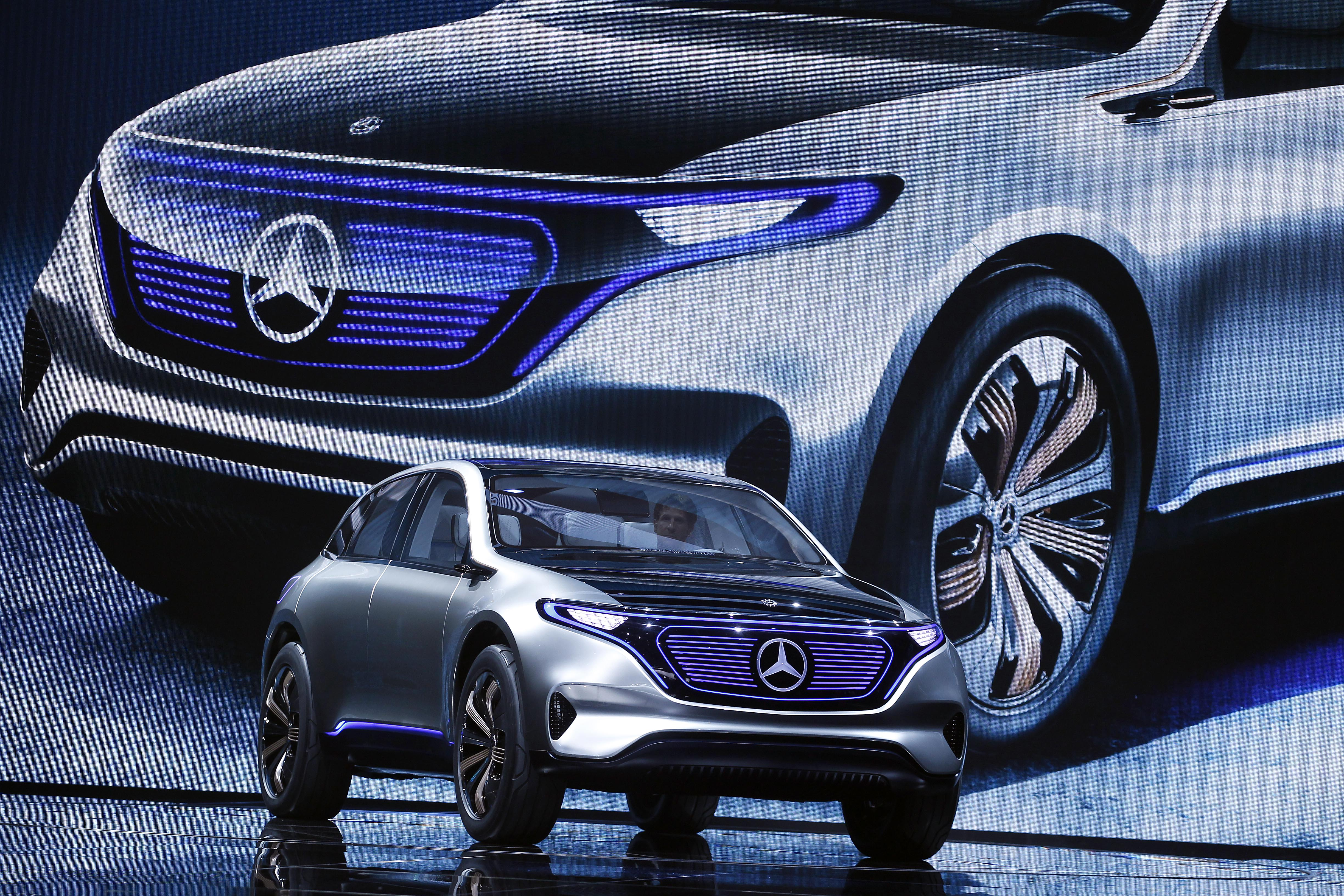 Dieter Zetsche, chief executive officer of Daimler AG, speaks on stage as he presents a new Mercedes-Benz Generation EQ concept sport-utility vehicle (SUV) during the 2016 press day of the Paris Motor Show.