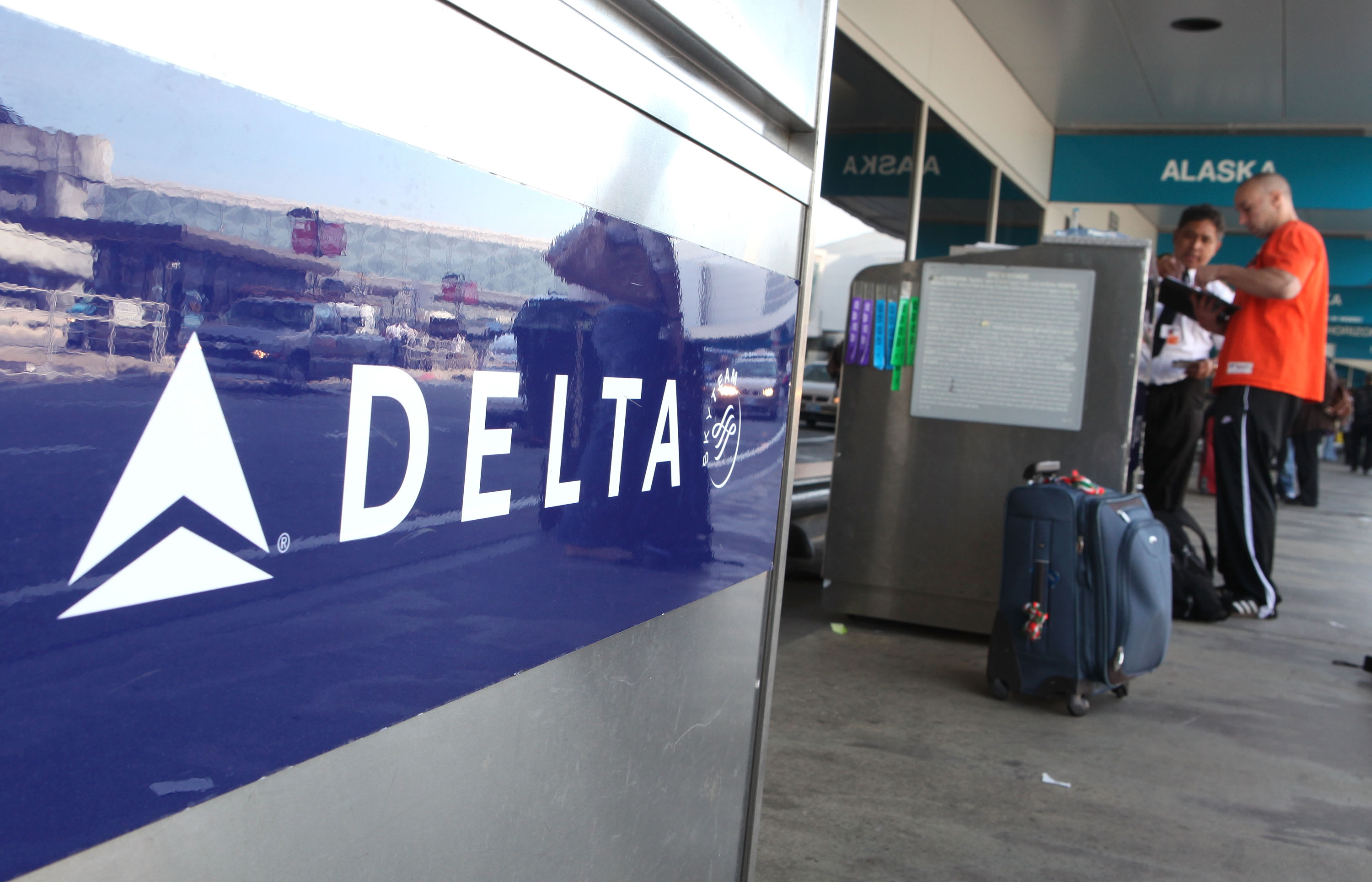 A Delta airlines customer checks his baggage at San Francisco International Airport.