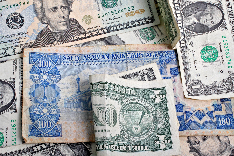 A Saudi Arabian one hundred riyal note and an assortment of
