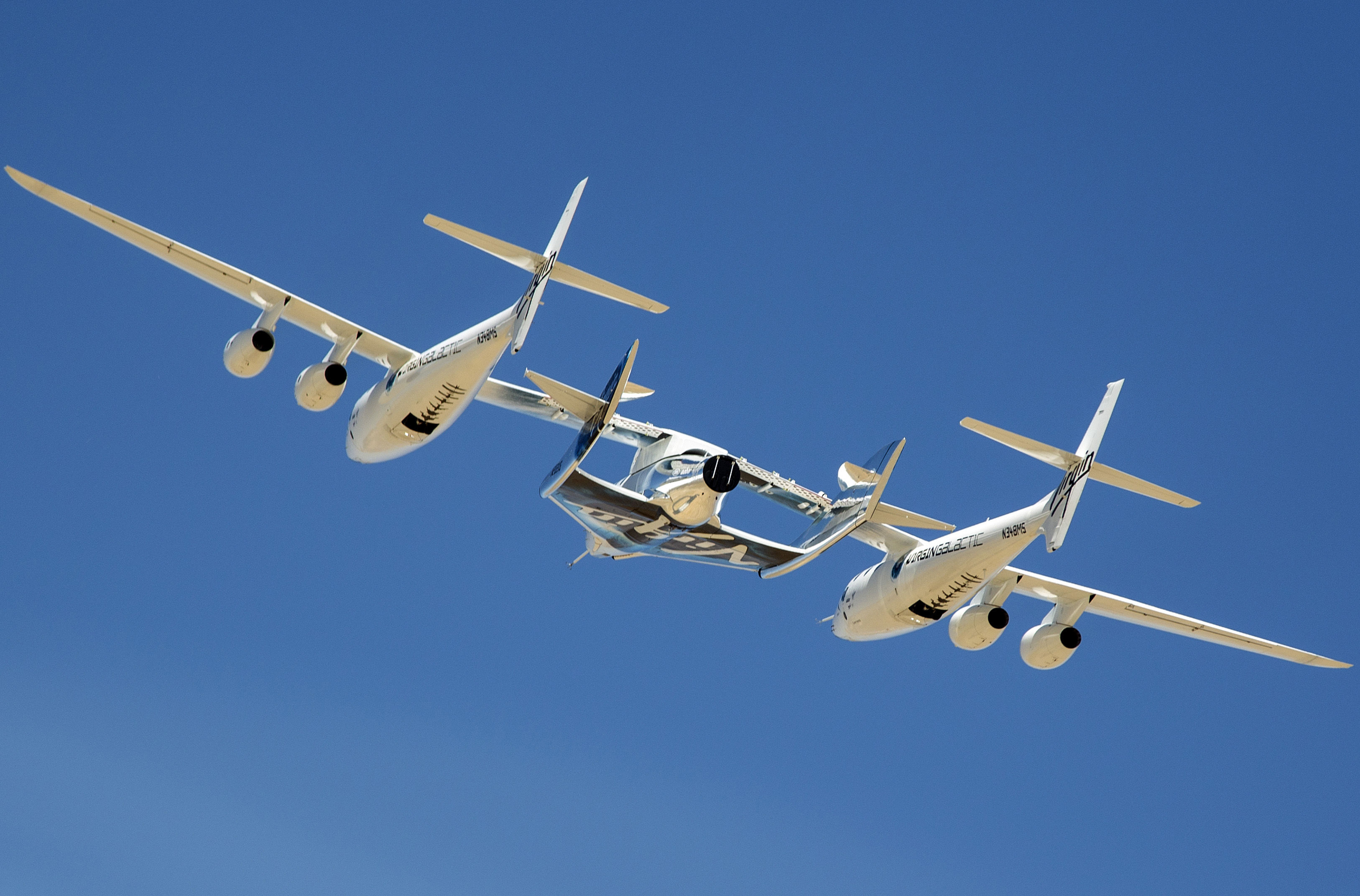 """Virgin Galactic's spaceplane and mothership, flying in """"captive carry"""" mode."""