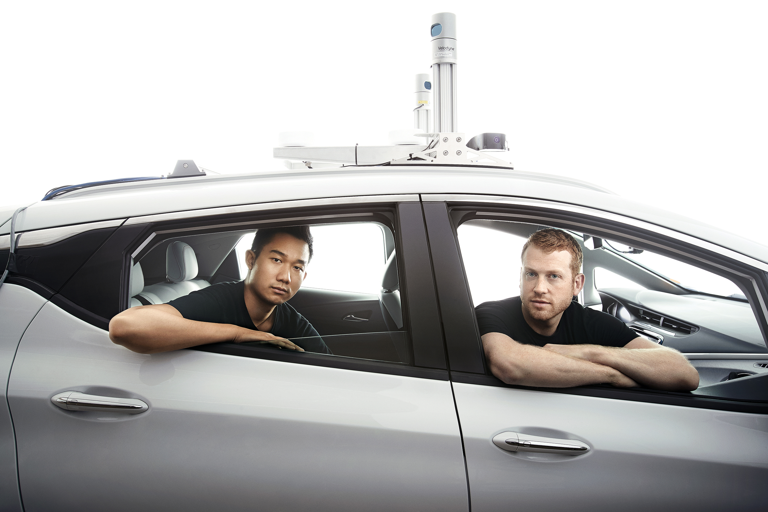 Cruise COO Daniel Kan (left) and CEO Kyle Vogt (right) in a Chevrolet self-driving-car prototype.