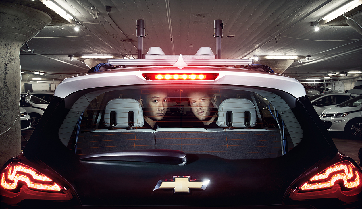 Cruise COO Daniel Kan (left) and CEO Kyle Vogt (right) in a Chevrolet self-driving-car prototype with a laser sensor on its roof.