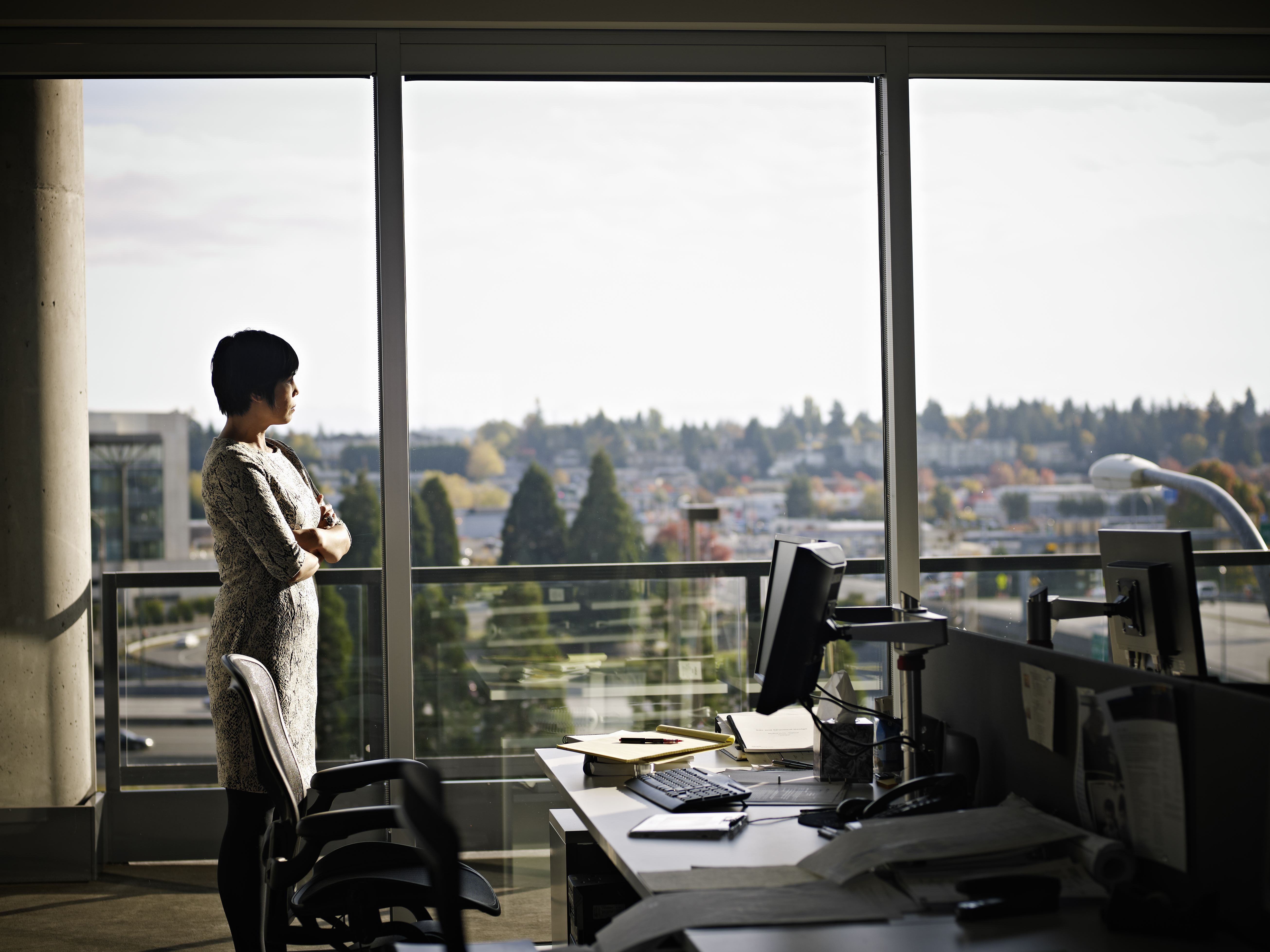 Businesswoman standing in office looking out