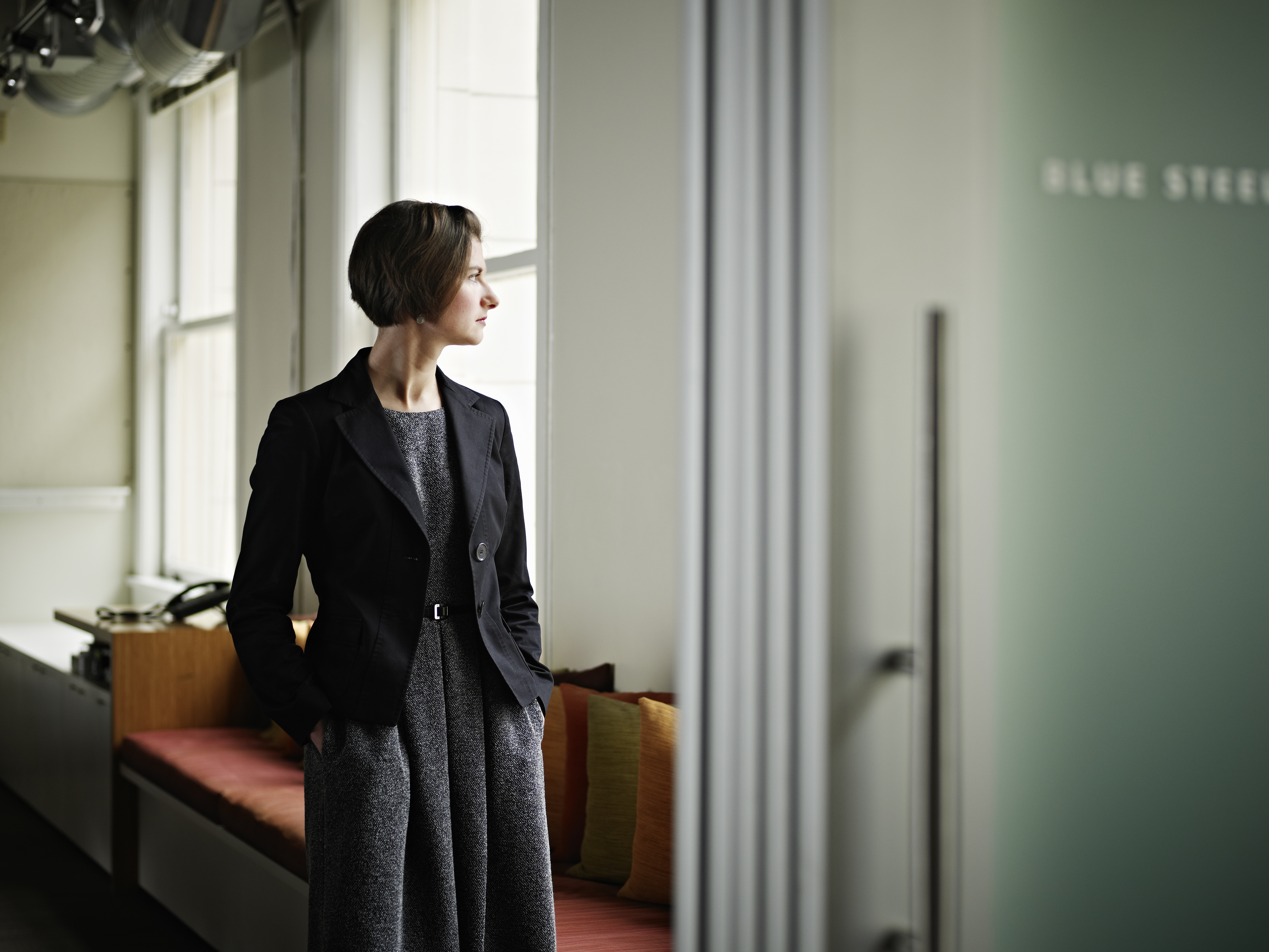 Businesswoman standing in office conference room