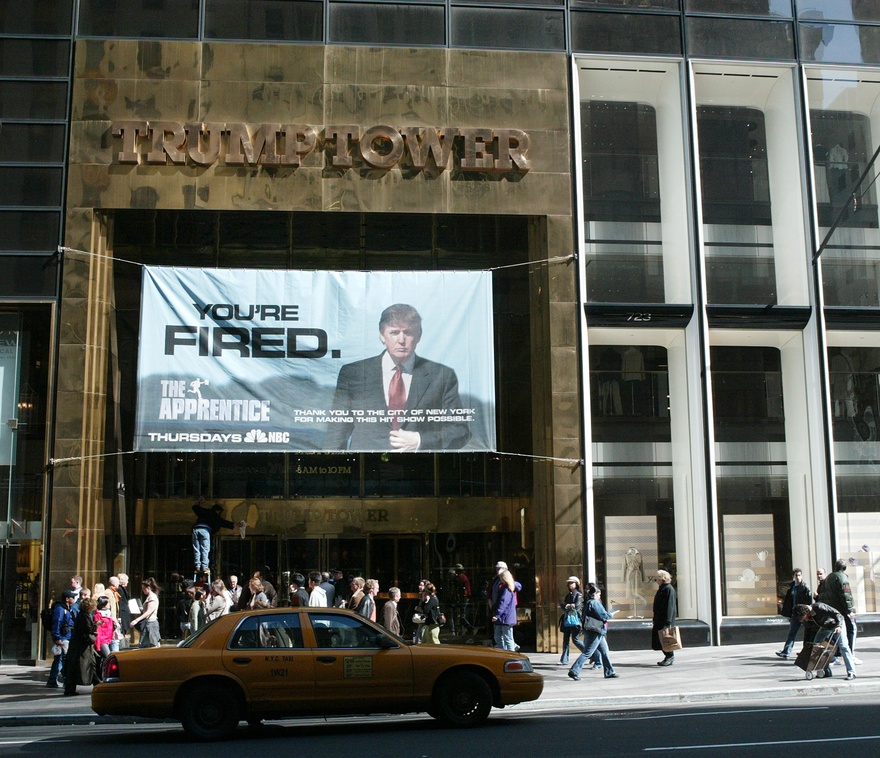 A sign advertising the television show 'The Apprentice' hangs at Trump Towers in 2004.
