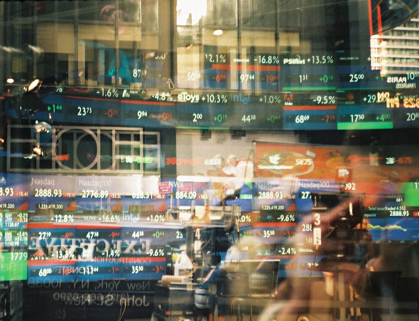 Reflection Of Financial Figures On Glass