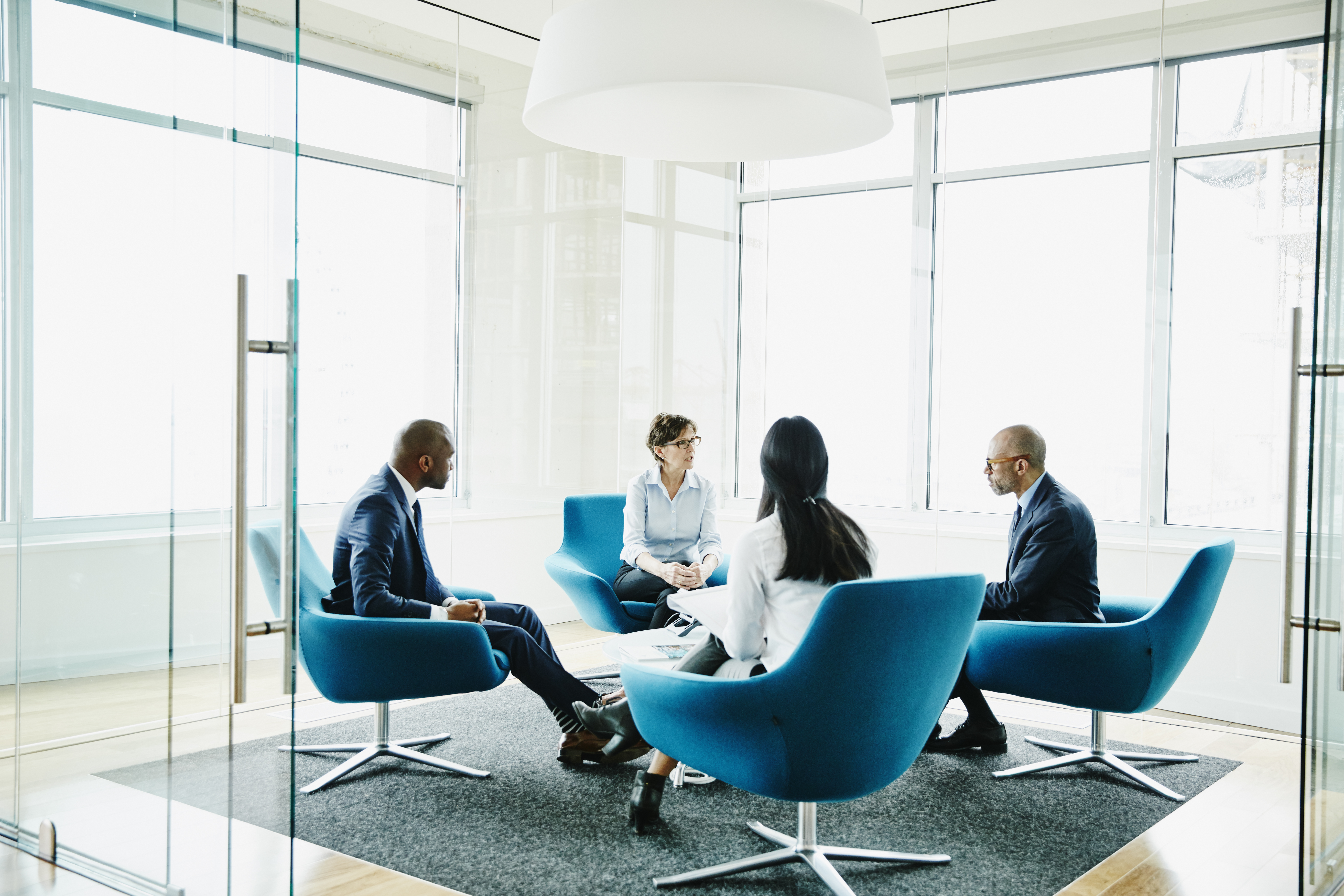 Mature businesswoman leading meeting in office