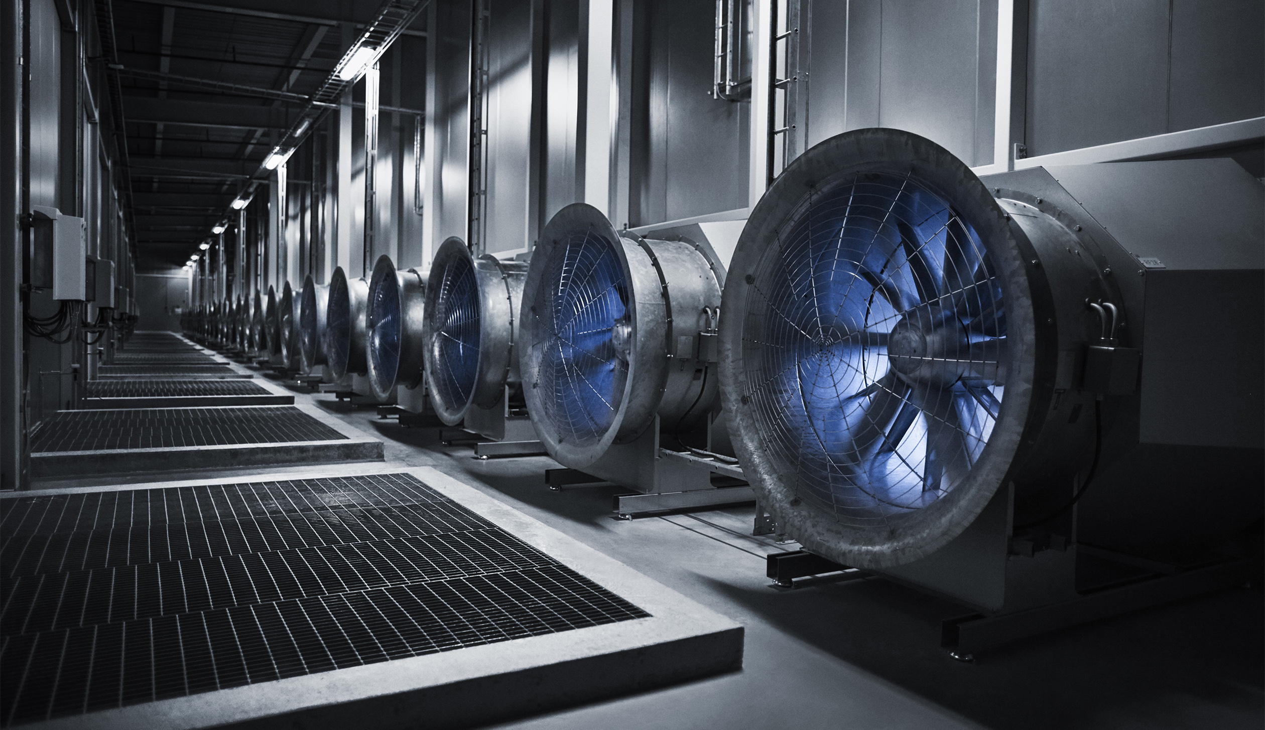 These enormous fans draw in the outside air to cool the servers in the data hall. In the winter, when temperatures plunge to -30 degrees the situation is reversed, and the heat from the servers warm the massive buildings.