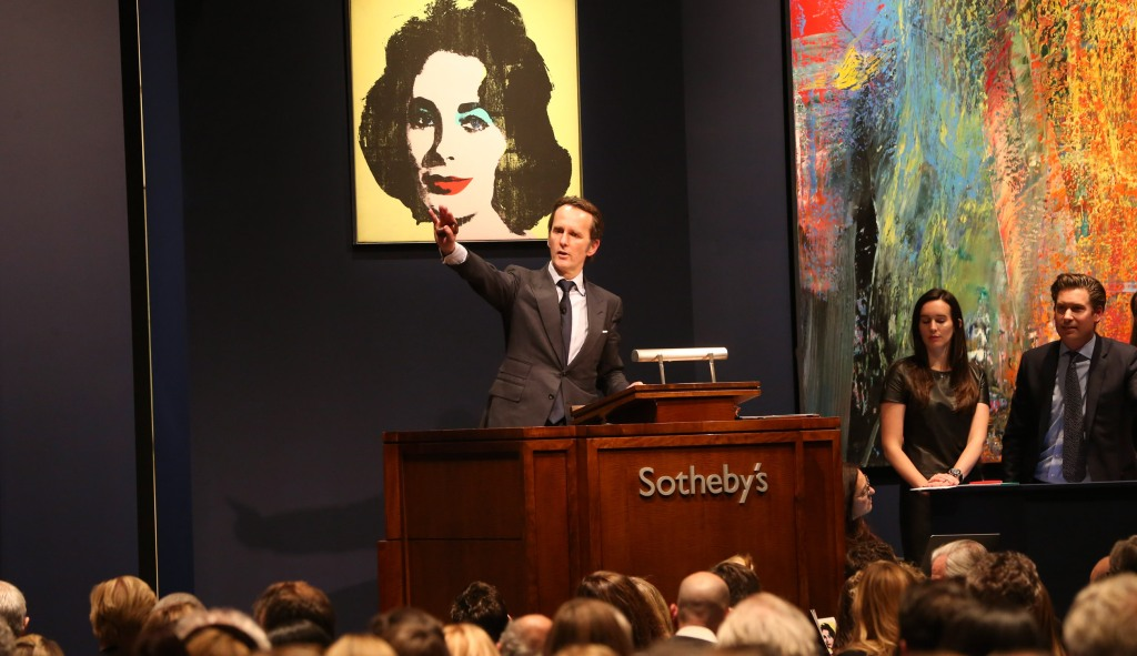 """""""Liz #1 (Early Colored Liz),"""" an Andy Warhol painting, sells for $20.3 million during a 2013 auction at Sotheby's in New York. As Sotheby's grapples with a seismic shift in the business of selling art, its largest shareholder, Daniel Loeb, has demanded change claiming the auction house has not adapted quickly enough to the changing market."""