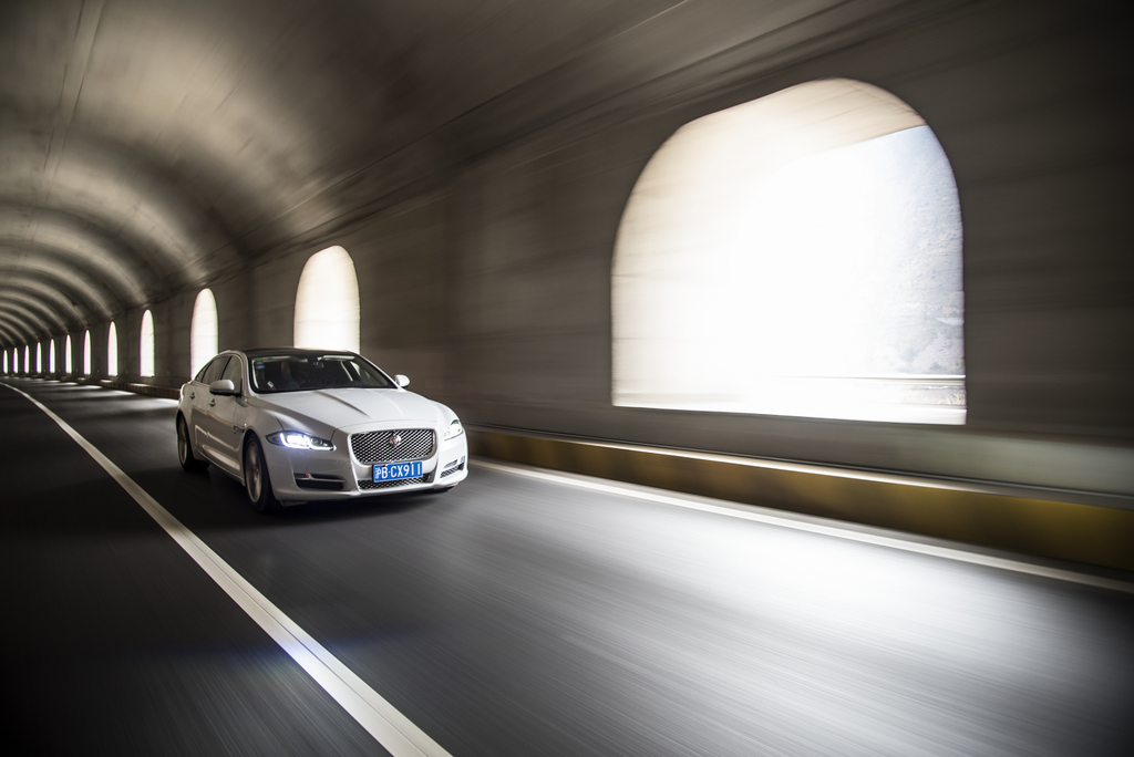 Jaguar Land Rover's XJ on the Yaxi 'Skyroad' Expressway in China.
