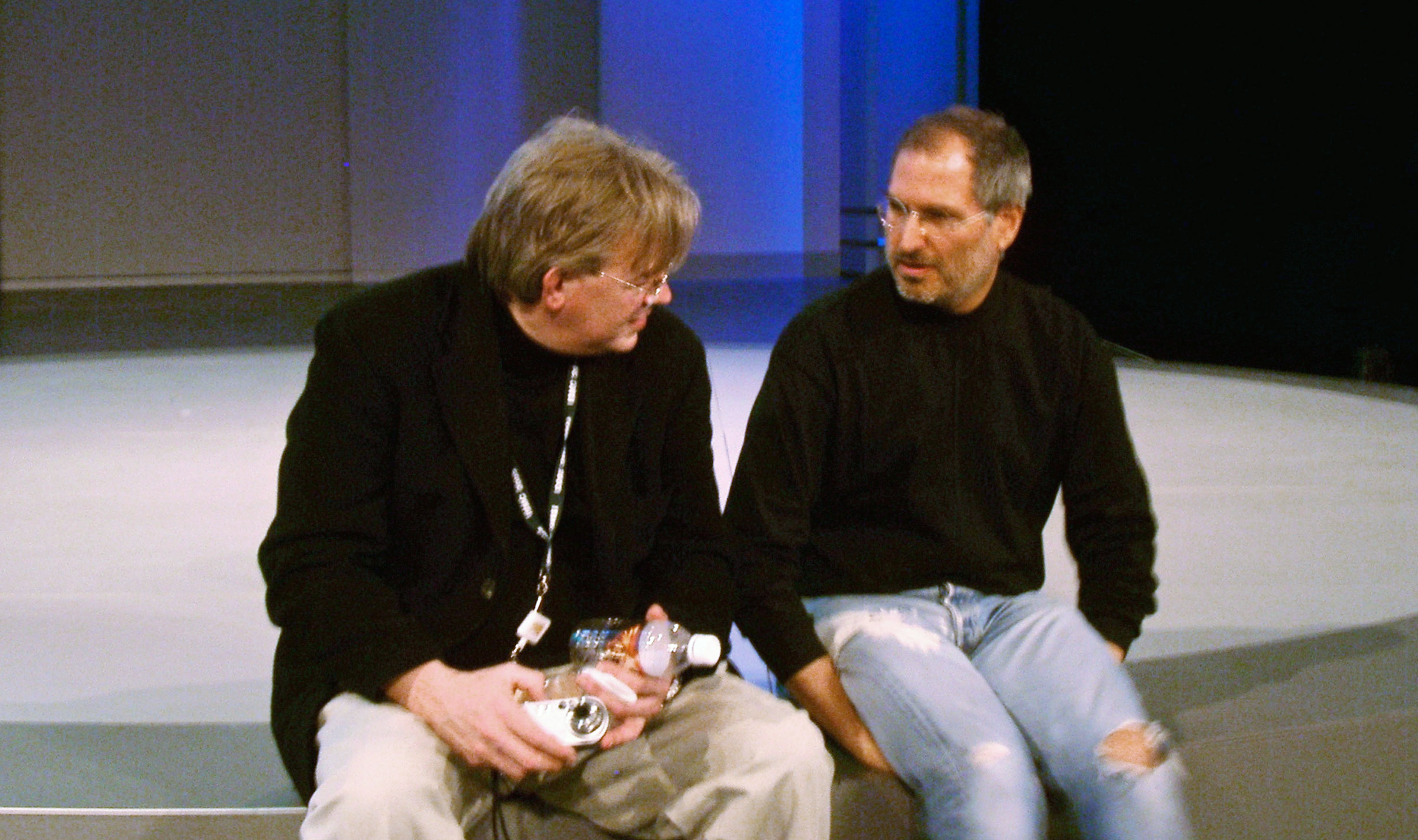 2001: Downtime: The men confer before Schlender (left) interviews Jobs and Andy Grove at a private Intel event.