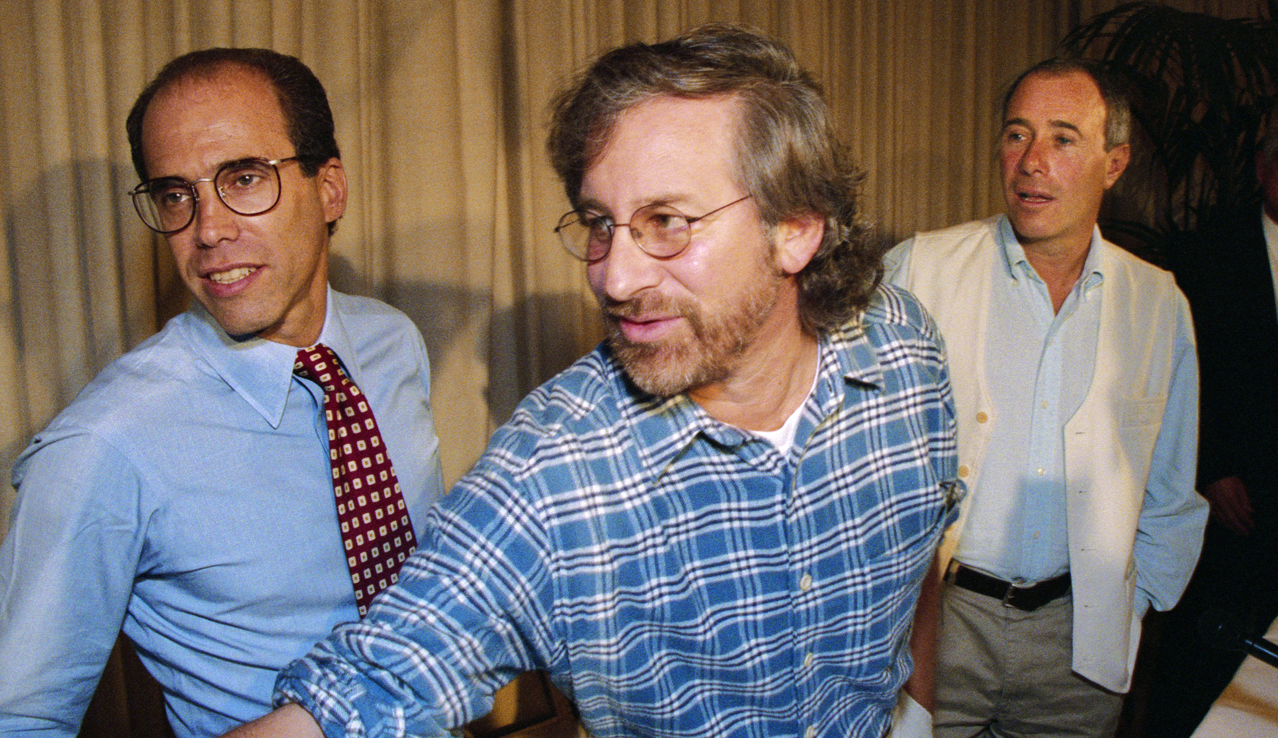 Jeffrey Katzenberg (left) with partners Steven Spielberg and David Geffen, announcing the launch of DreamWorks SKG in October 1994. DreamWorks Animation split off as an independent company with Katzenberg as CEO in 2004