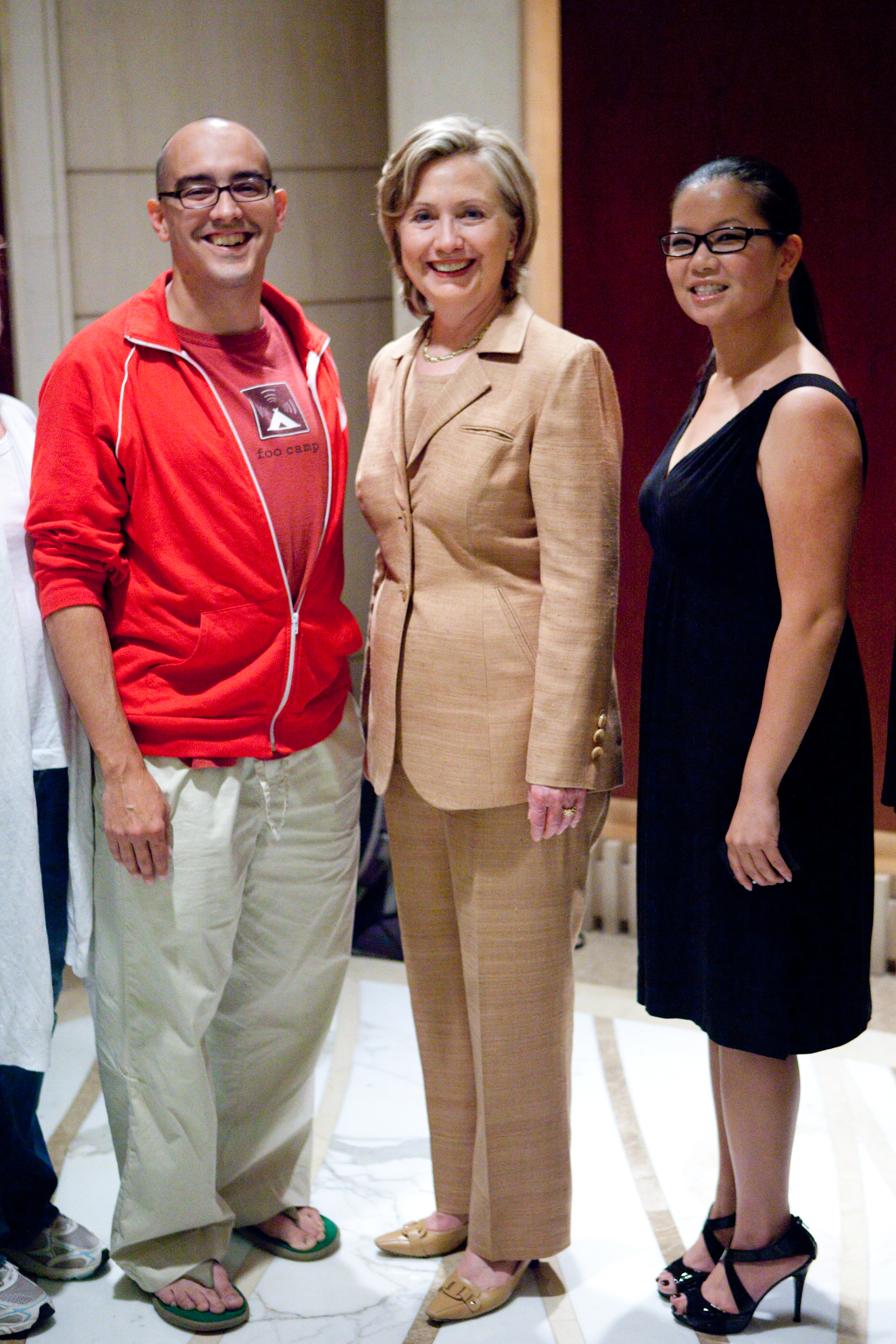 500 Startups' Dave McClure, in flip-flops, with presidential candidate Hillary Clinton and Christine Lu, a 500 Startups entrepreneur.