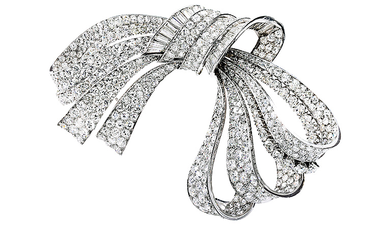 A Van Cleef & Arpels brooch set with single-cut and old European diamonds.