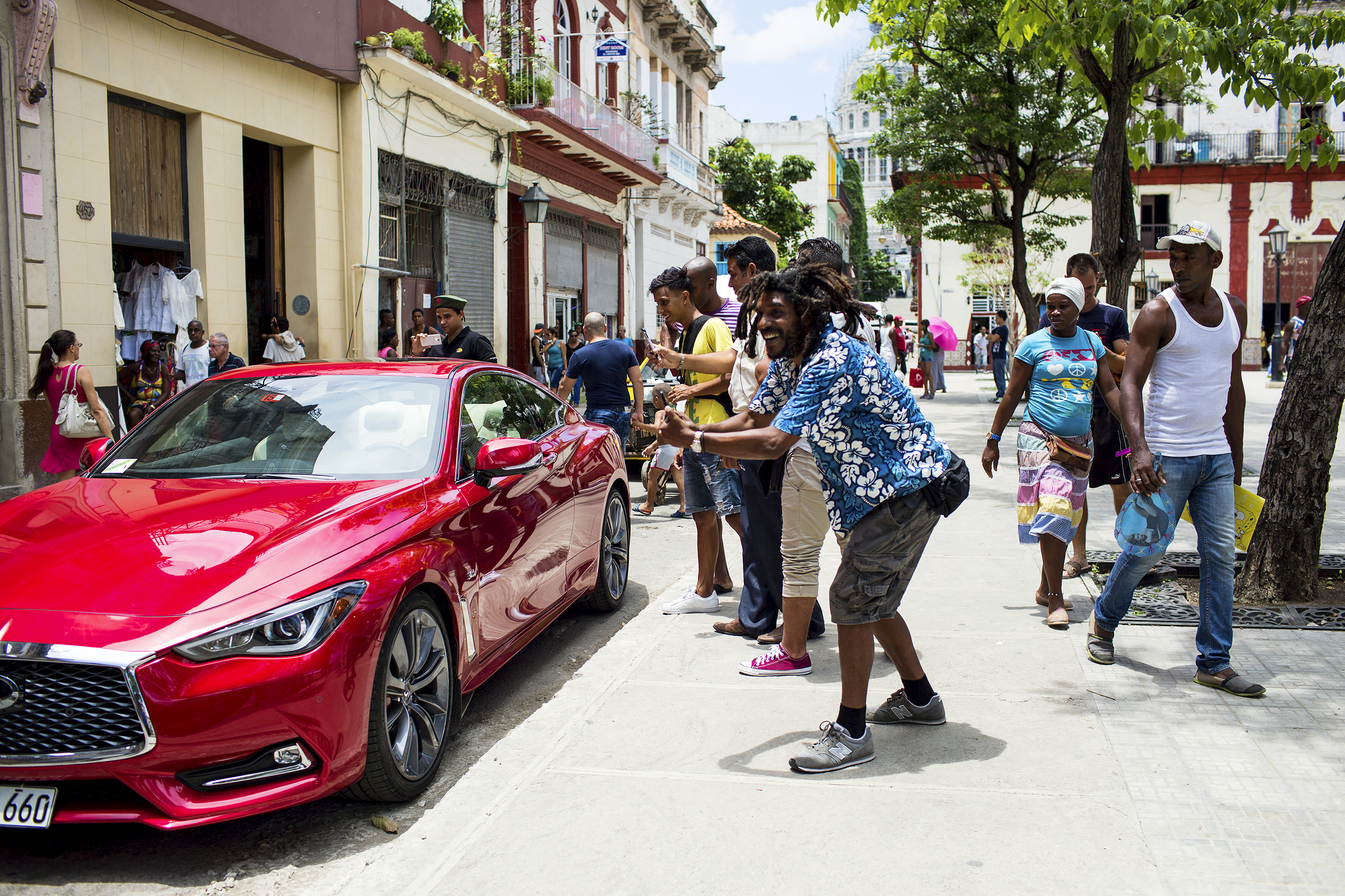 Residents of Old Havana admire the Infiniti Q60.