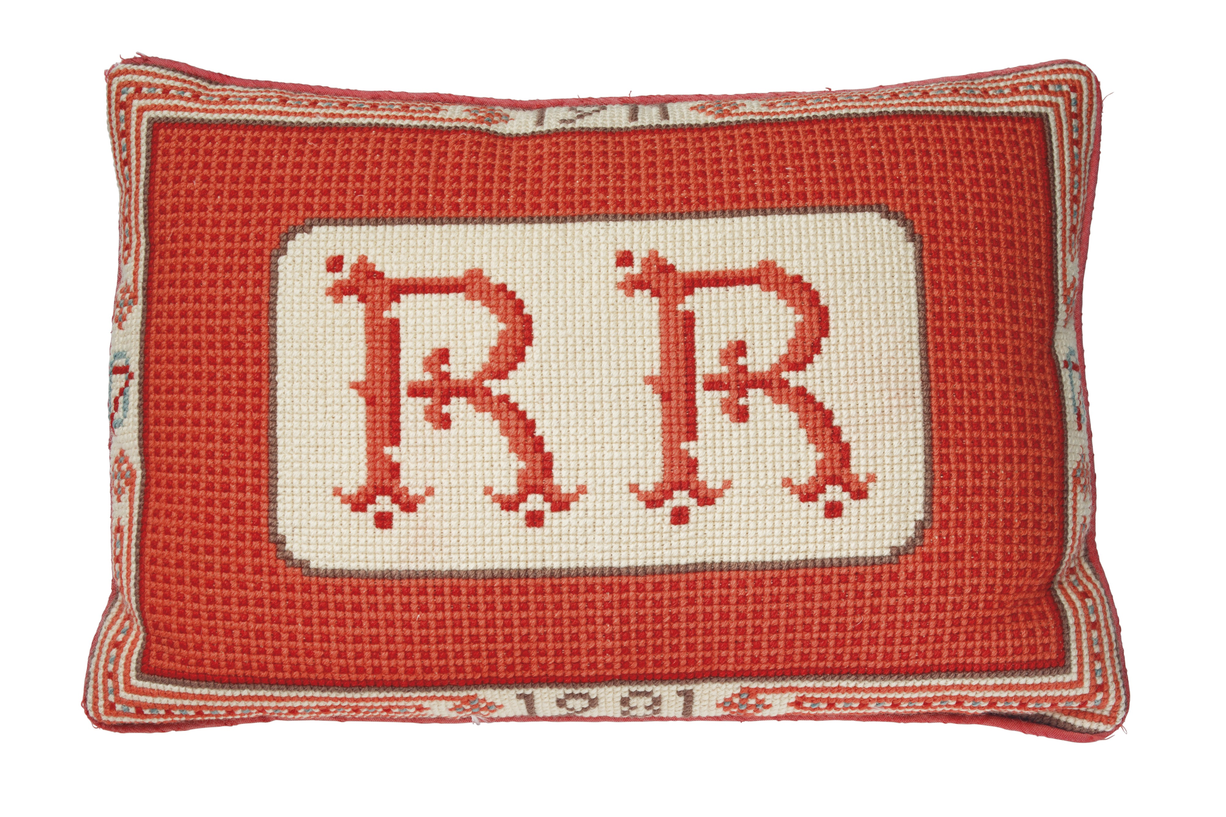 President Reagan's 70th birthday present, a red monogrammed needlepoint cushion. It sold for $25,000.