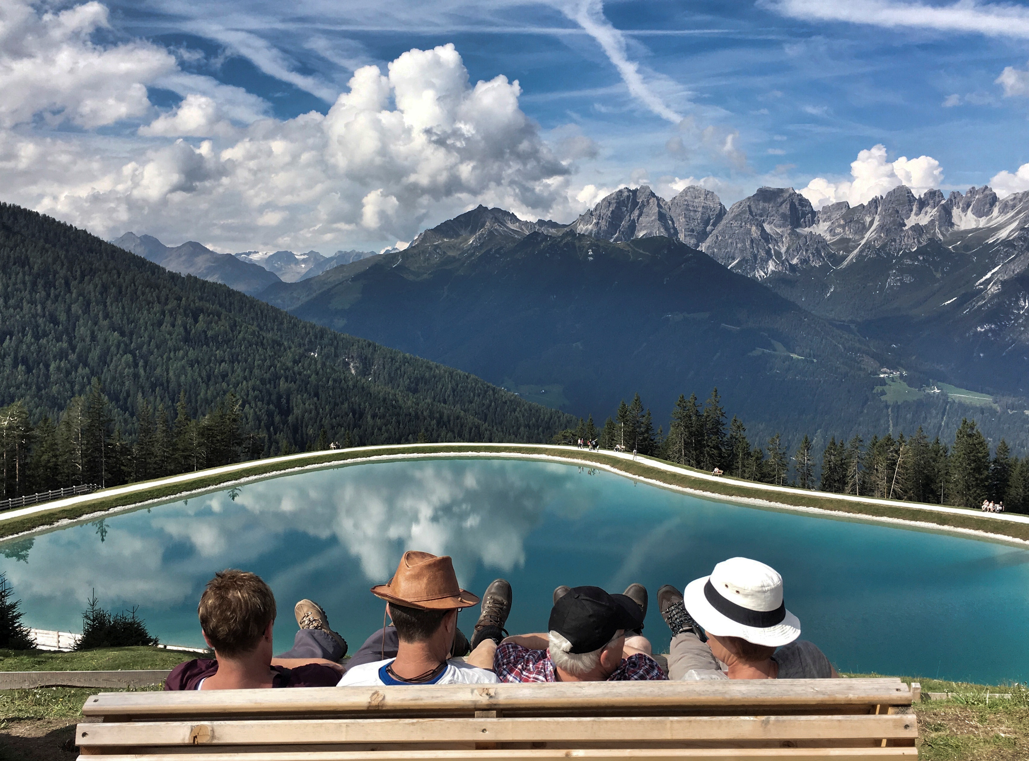 Vacation People enjoy the view from Serles mountain on a sunny autumn day in the western Austrian village of Mieders