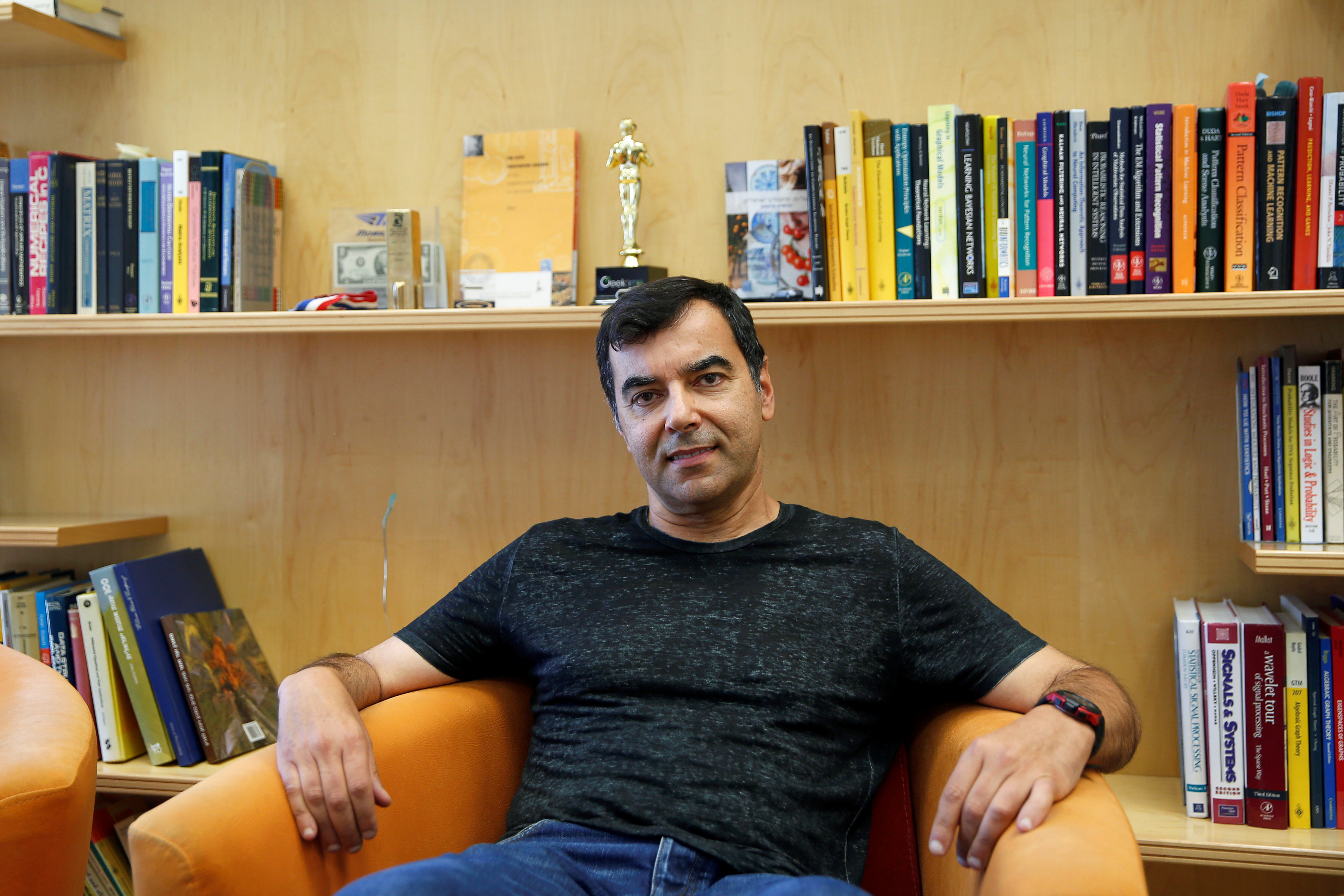 Chairman of Israeli driving assistant software maker Mobileye NV, Amnon Shashua, poses for a photograph at his office in Jerusalem