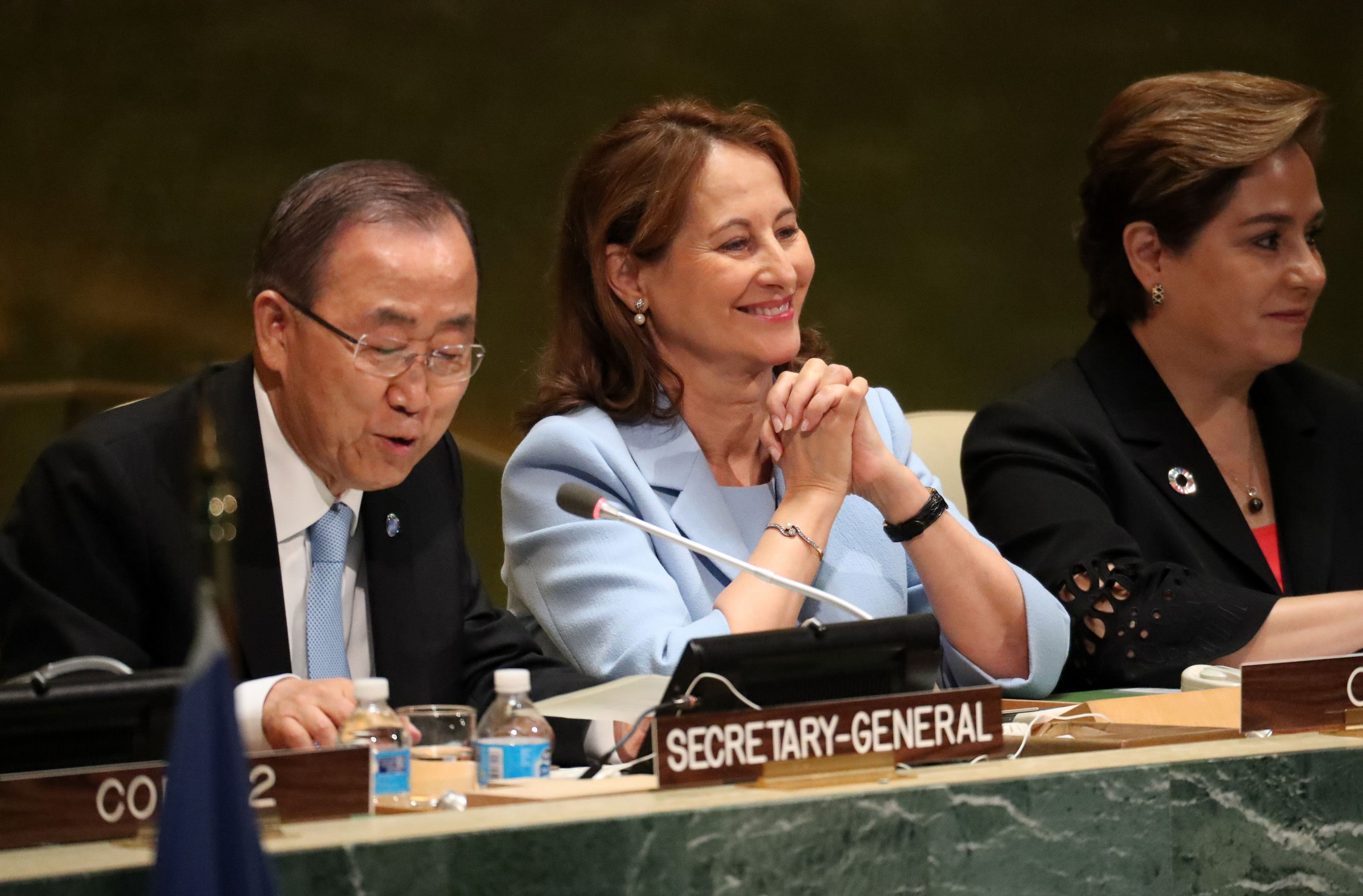 French Minister for Environment Segolene Royal sits with U.N. Secretary General Ban Ki-moon at United Nations headquarters in New York