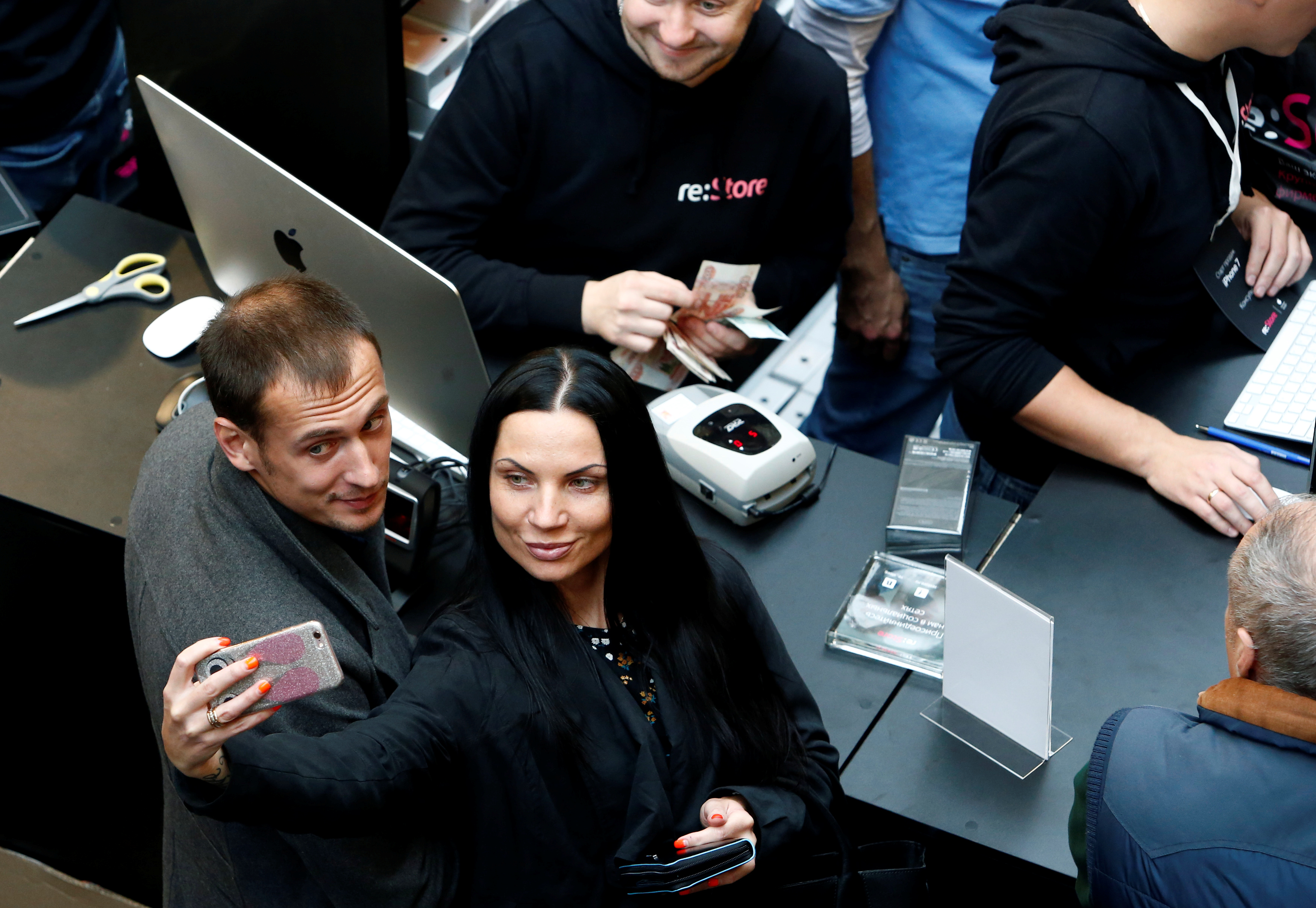 Customers gather at a store selling Apple products during launch of new iPhone 7 sales in Moscow