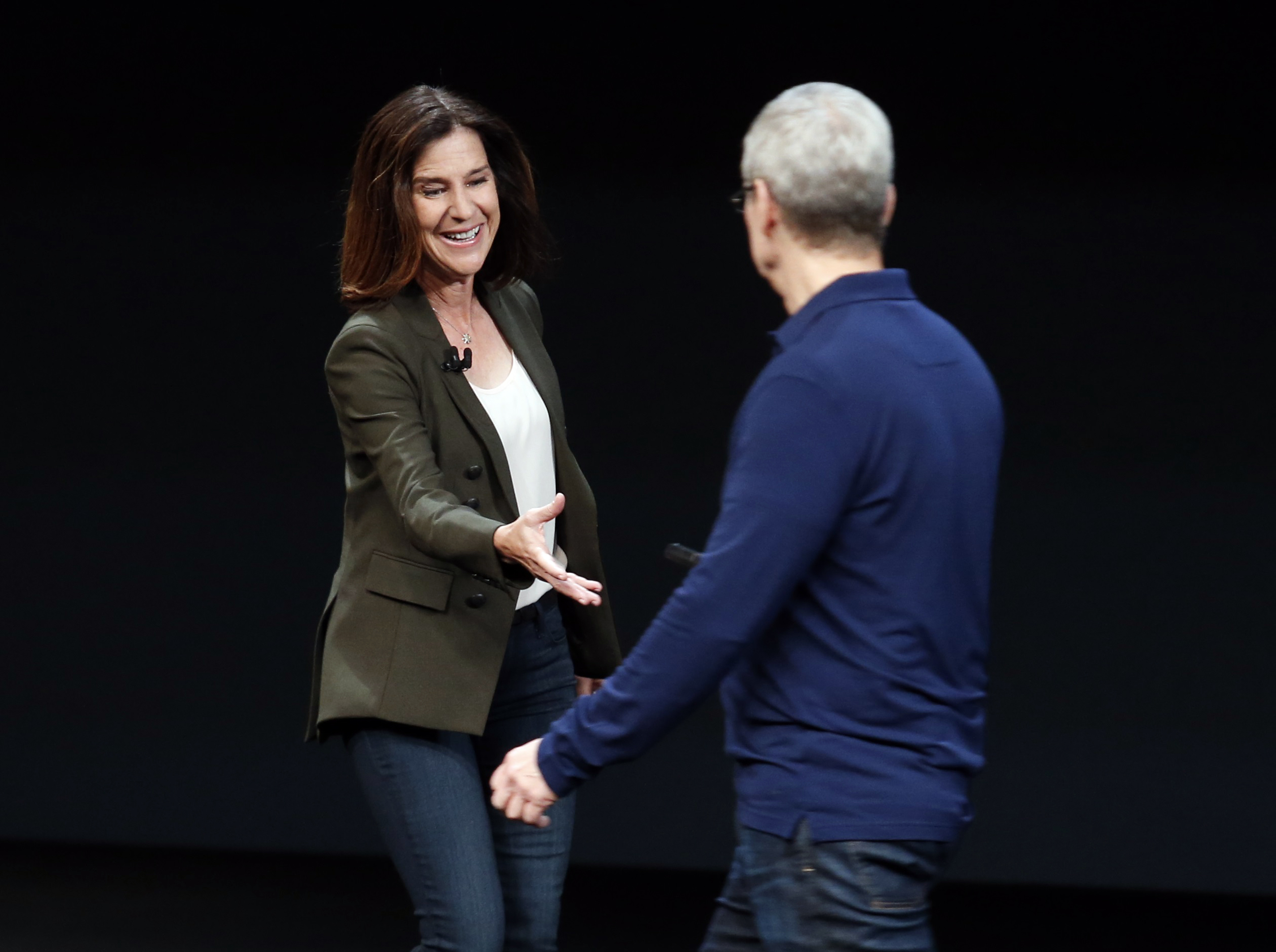 Susan Prescott is greeted by Tim Cook during an Apple media event in San Francisco