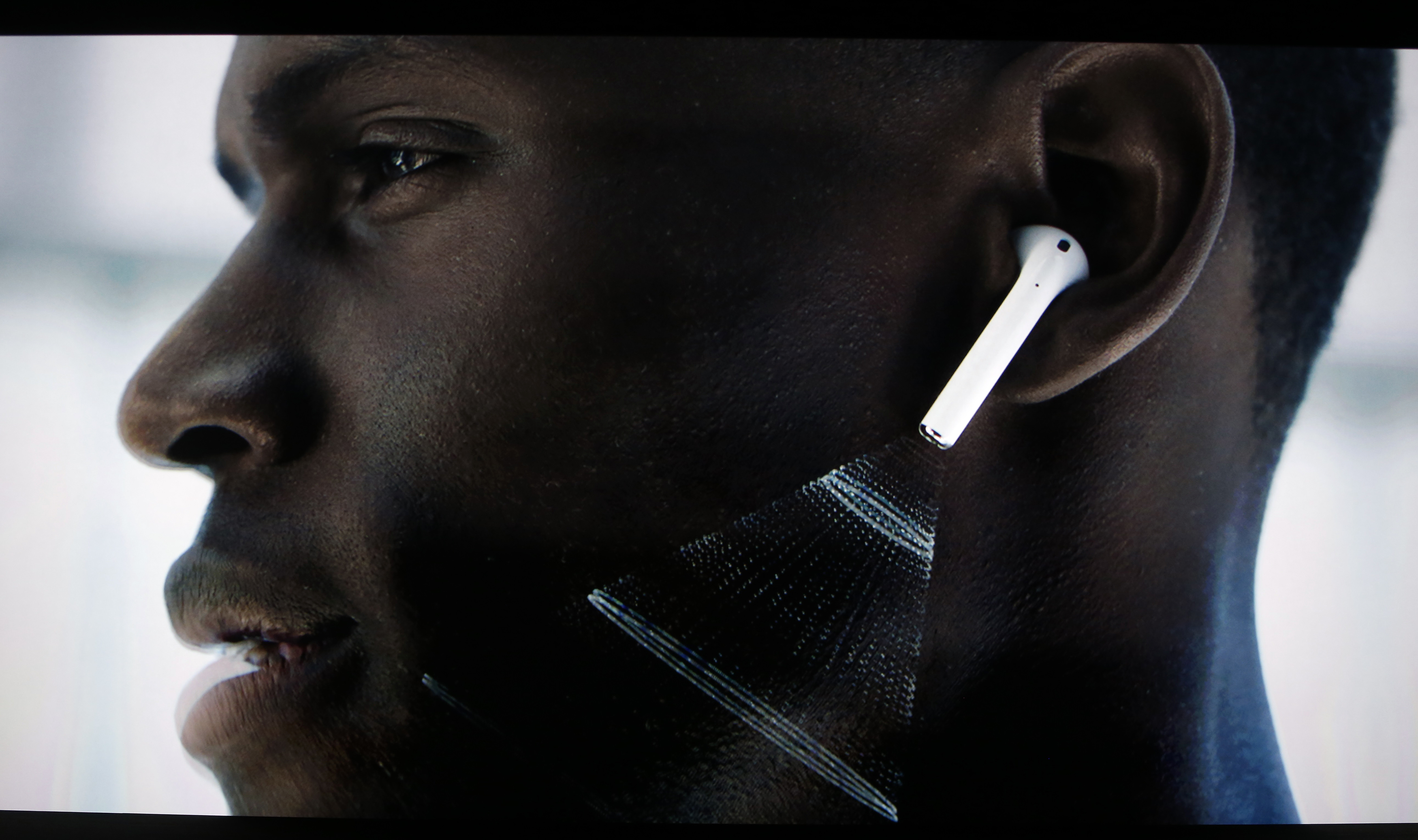 Video screen image of Apple AirPods during a media event in San Francisco