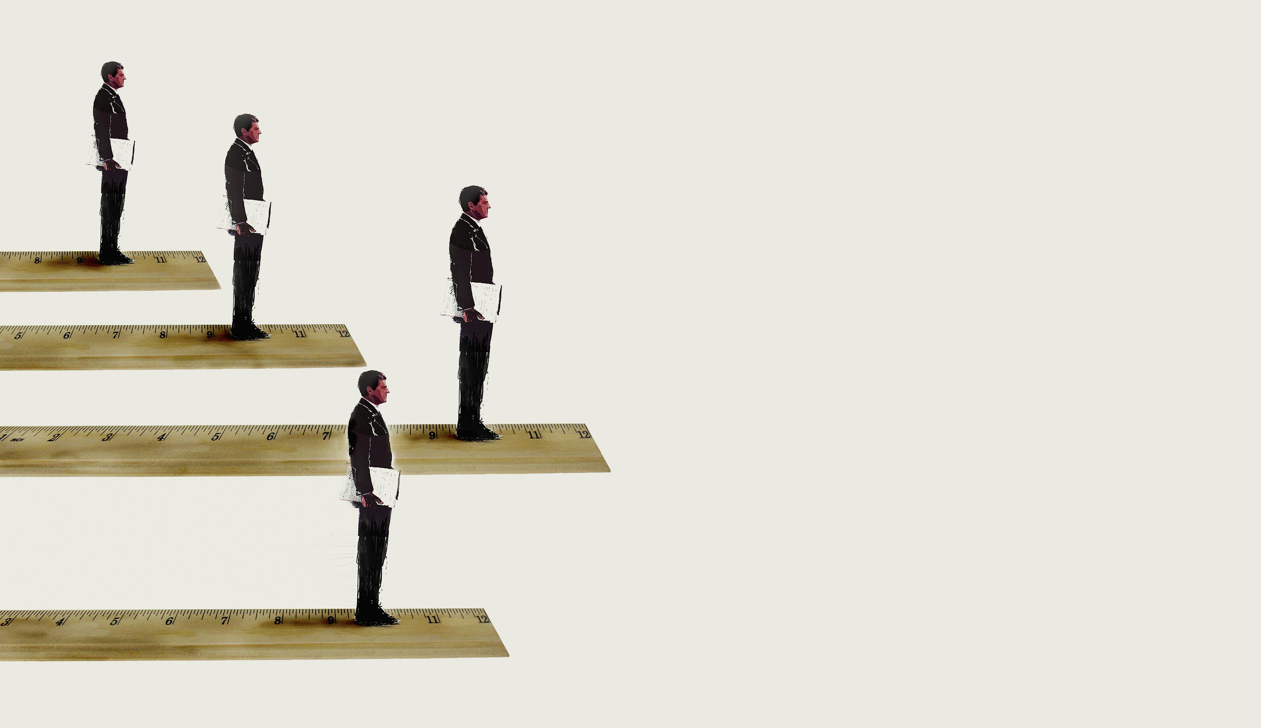 Businessmen standing in rank order on rulers