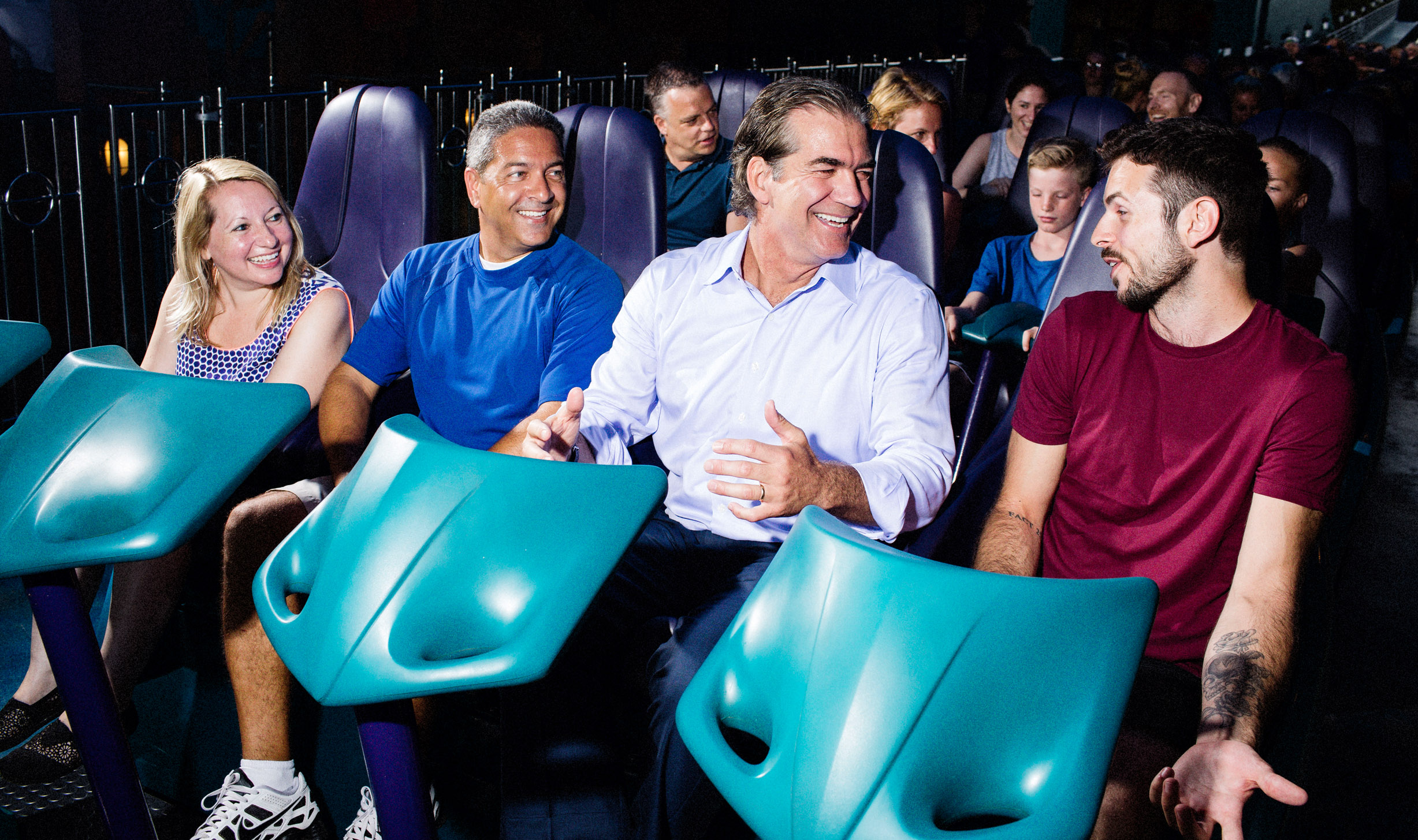 """Joel Manby, second from right, prepares to ride """"Mako"""" the fastest roller coaster in Orlando."""