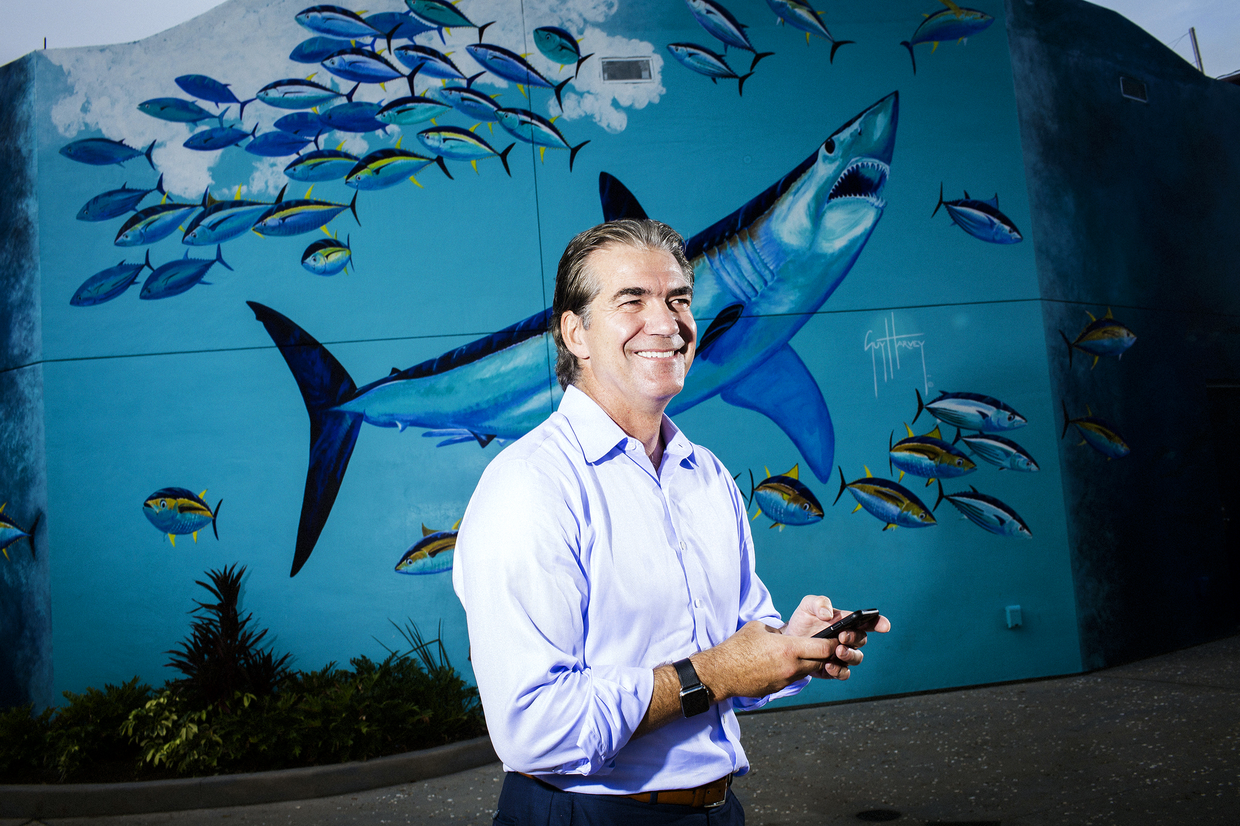 Joel Manby outside SeaWorld Orlando's shark-themed roller coaster, a new attraction that's central to Manby's makeover strategy.