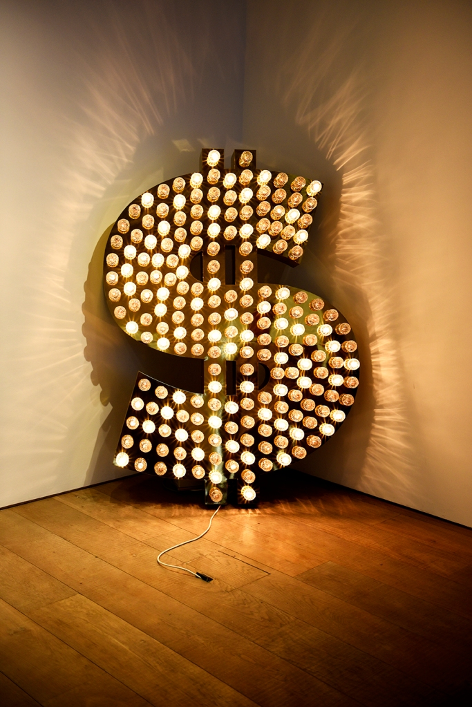 Tim Noble and Sue Webster's '$, 2001' sold above estimate for $171,000 in a June 2015 Sotheby's sale in London, as part of an exhibition of pieces inspired by the US Dollar.